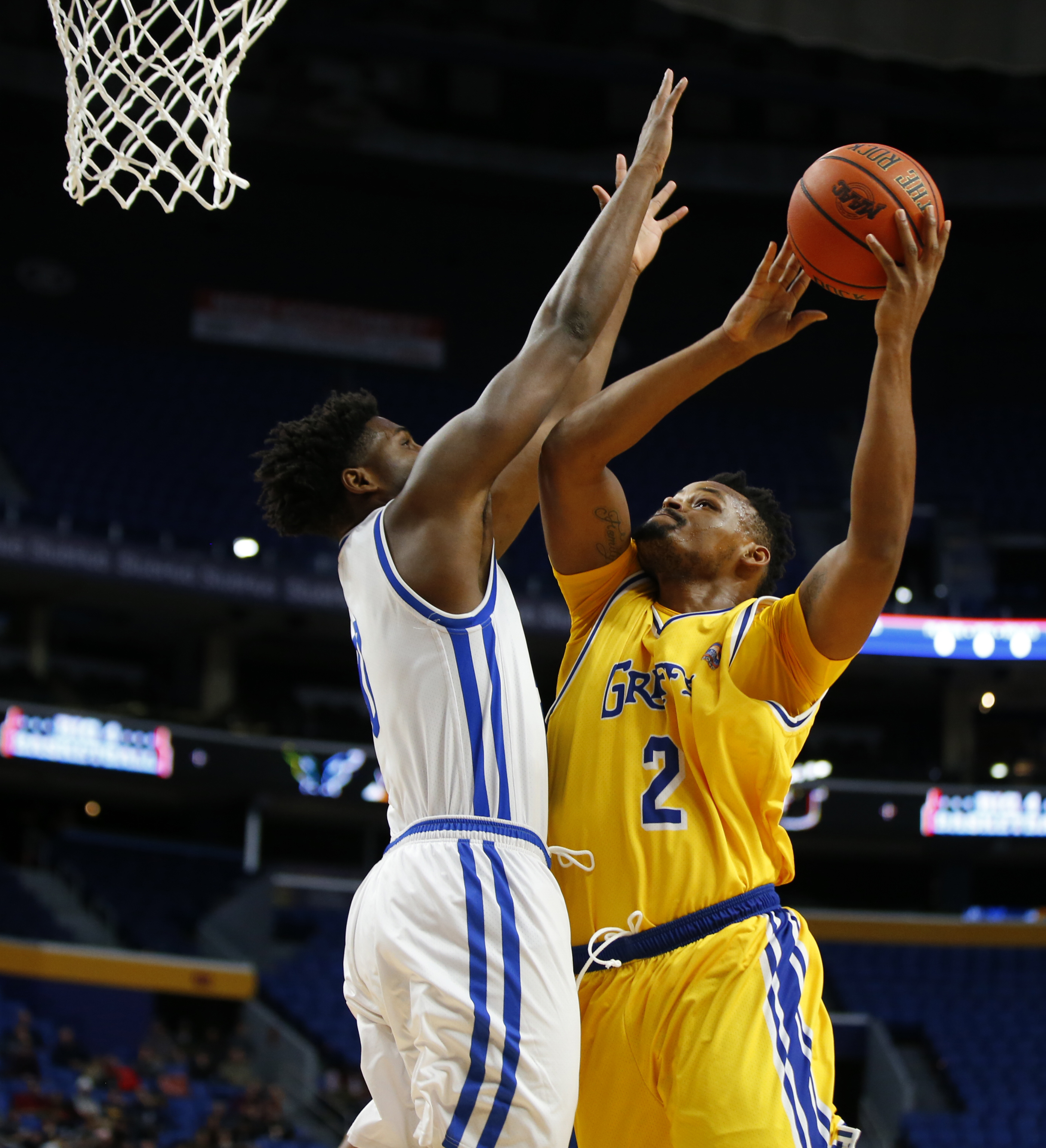 Canisius Jermaine Crumpton drives to the basket against the University at Buffalo during first half action at the Big 4 classic at the Key Bank Center Saturday (Harry Scull Jr./Buffalo News)
