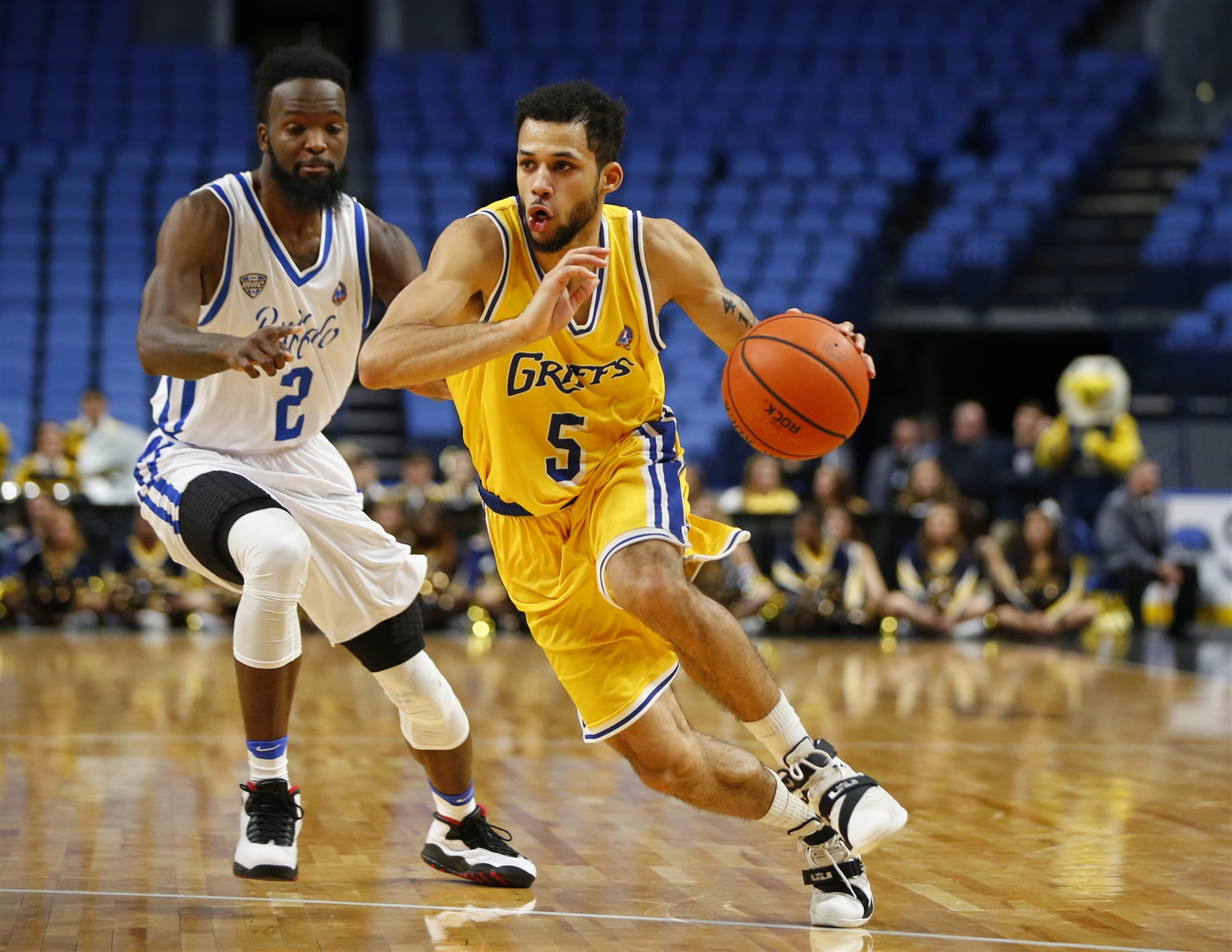 Canisius' Kassius Robertson dribbles against UB at the Big 4 Classic. (Harry Scull Jr./Buffalo News)