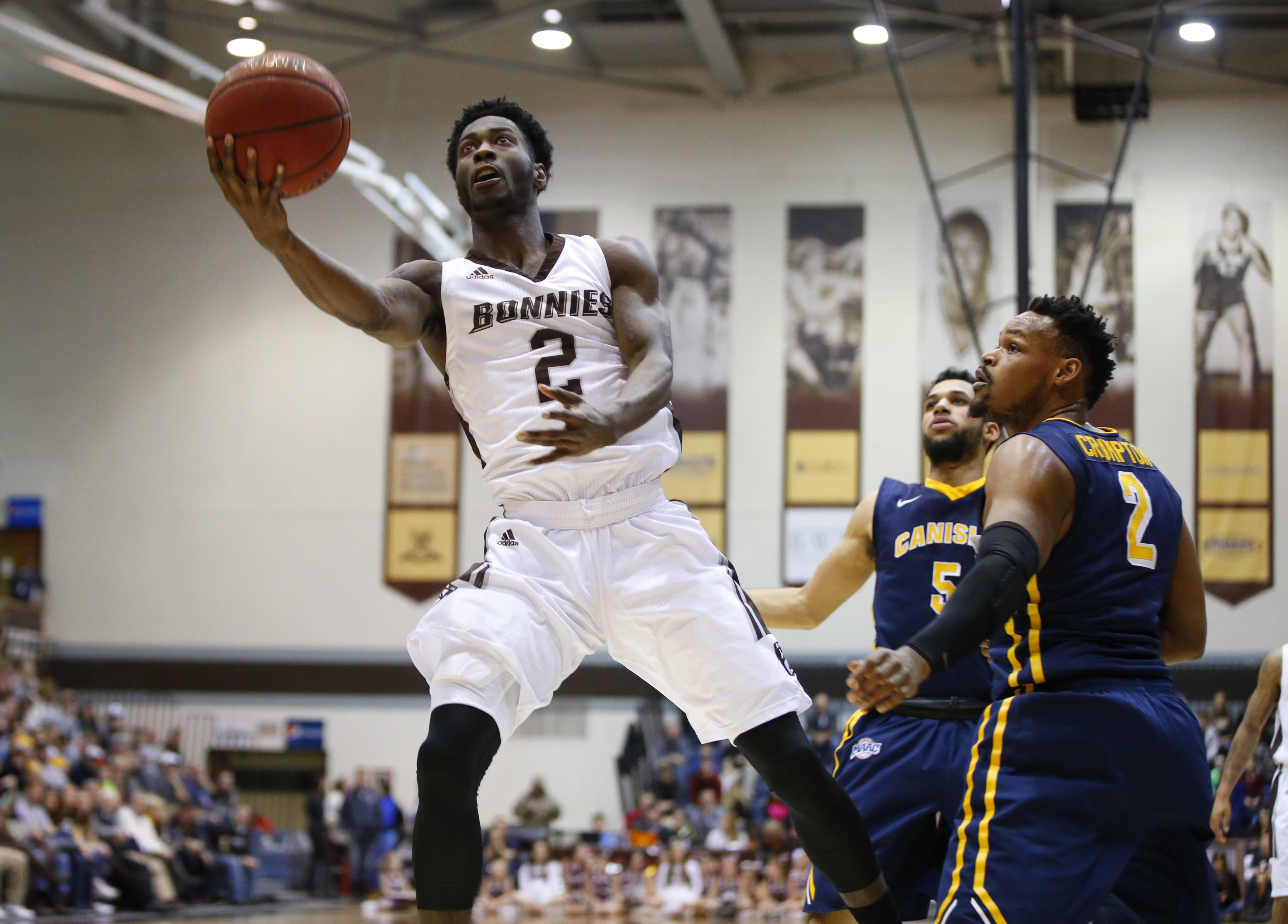 Canisius Jeraine Crumpton watches St. Bonaventure's Matt Mobley drive to the basket during second half action at the Reilly Center on Thursday, Dec. 22, 2016. (Harry Scull Jr./Buffalo News)