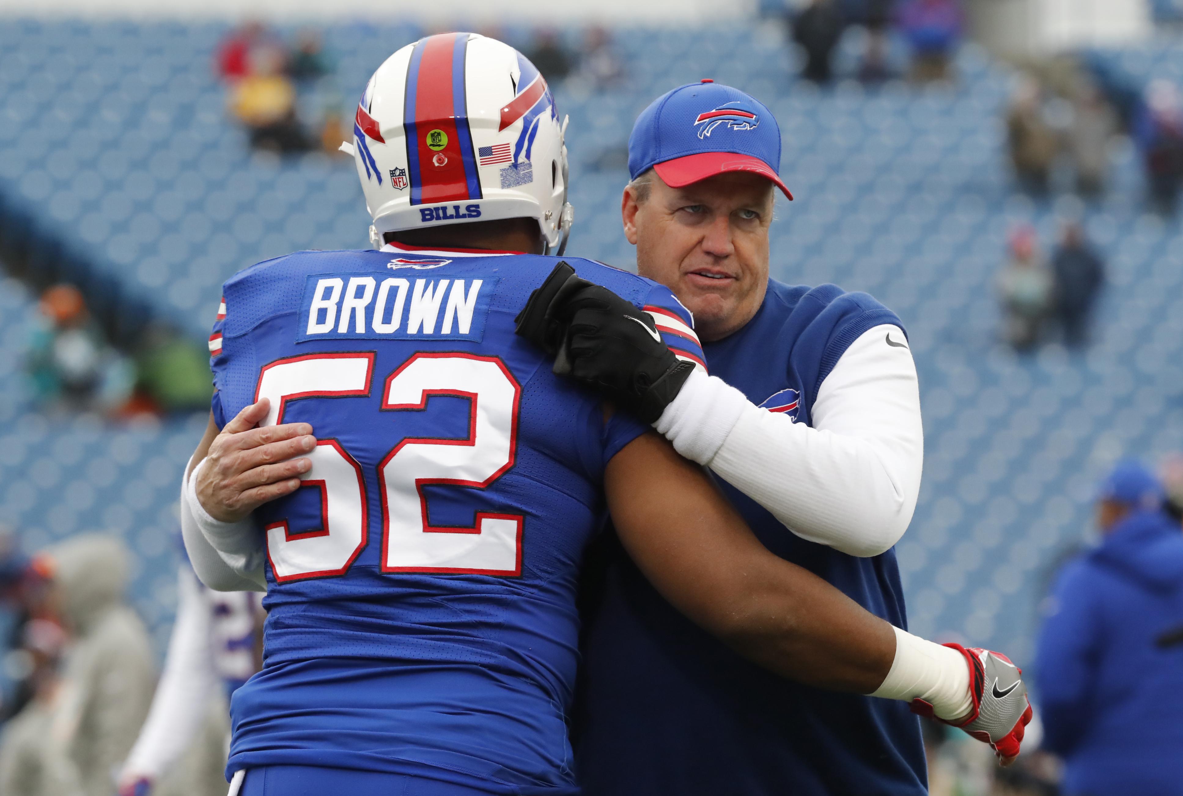 Buffalo Bills coach Rex Ryan hugs Preston Brown prior to Saturday's game. (Harry Scull Jr./Buffalo News)