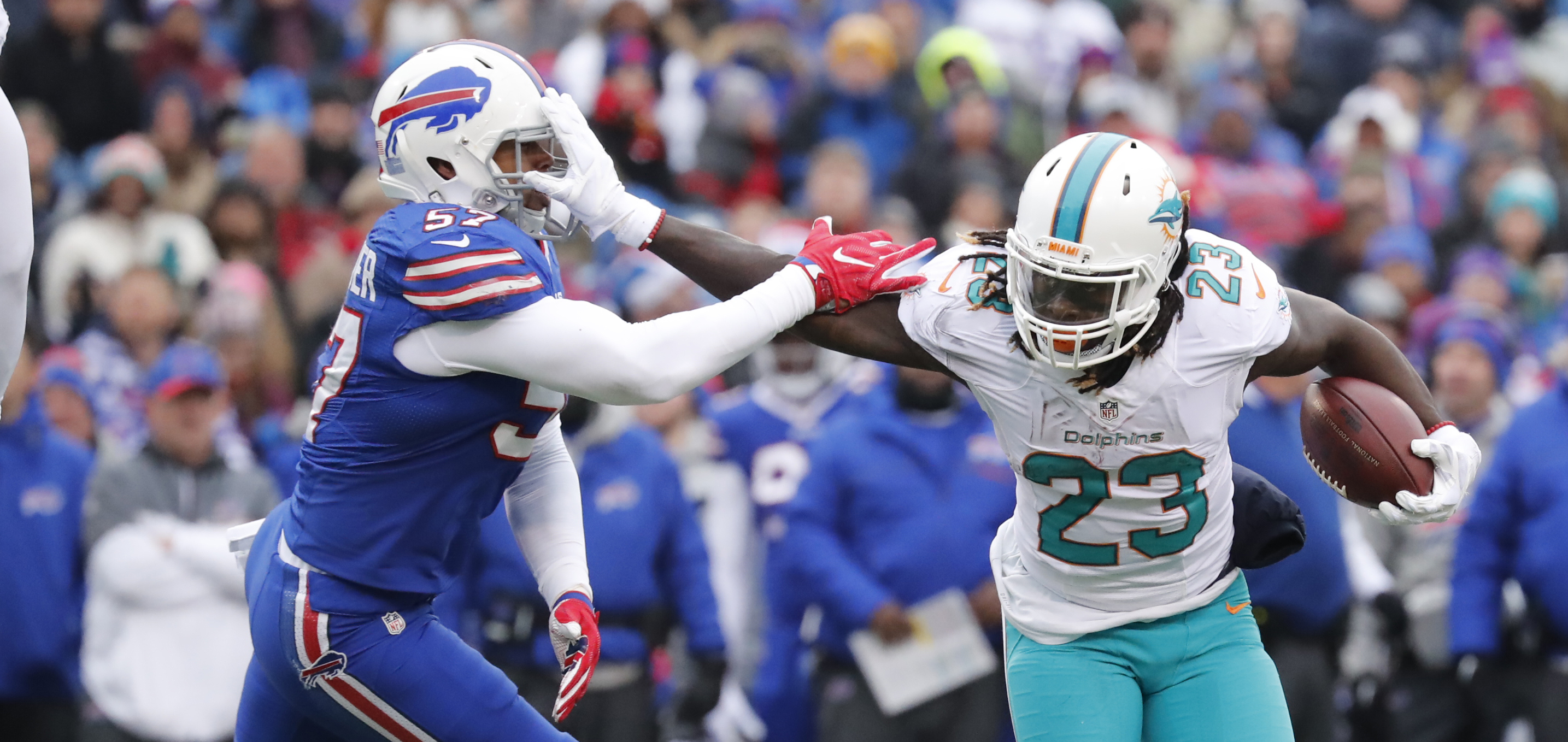Lorenzo Alexander gets stiff-armed by the Miami Dolphins' Jay Ajayi during the first half. (Harry Scull Jr./Buffalo News)