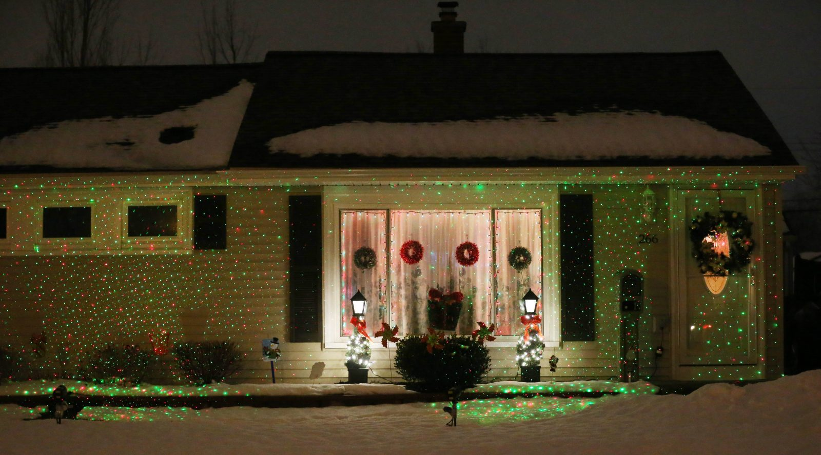Projected Christmas laser lights have become a popular and easy way to decorated home exteriors.  They decorate this home on Faraday Road in the Town of Tonawanda. (Sharon Cantillon/Buffalo News)