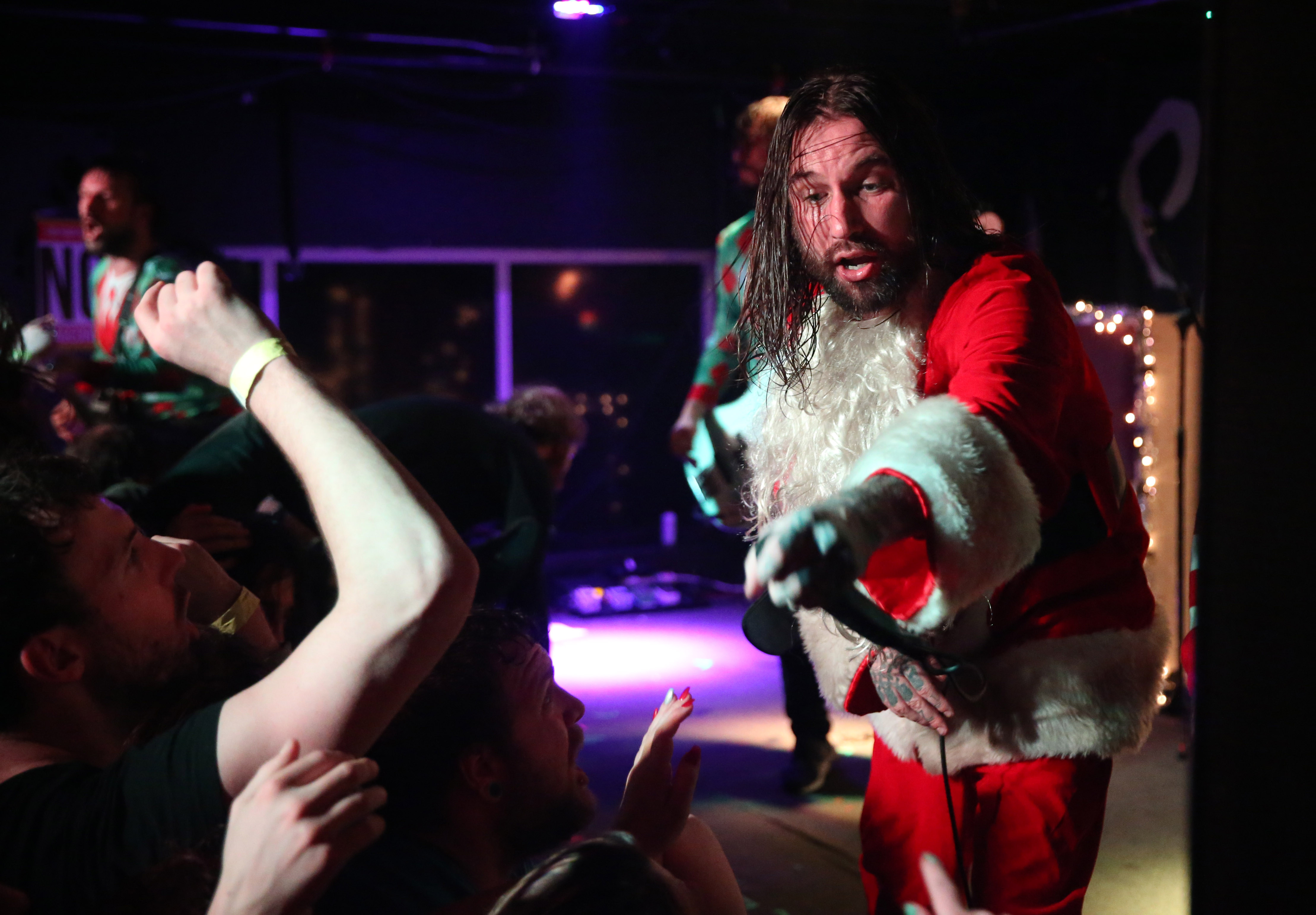 Internationally known Buffalo band Every Time I Die came dressed as Santa and his elves for their annual Christmas show. Here, lead singer Keith Buckley as Santa.  (Sharon Cantillon/Buffalo News)
