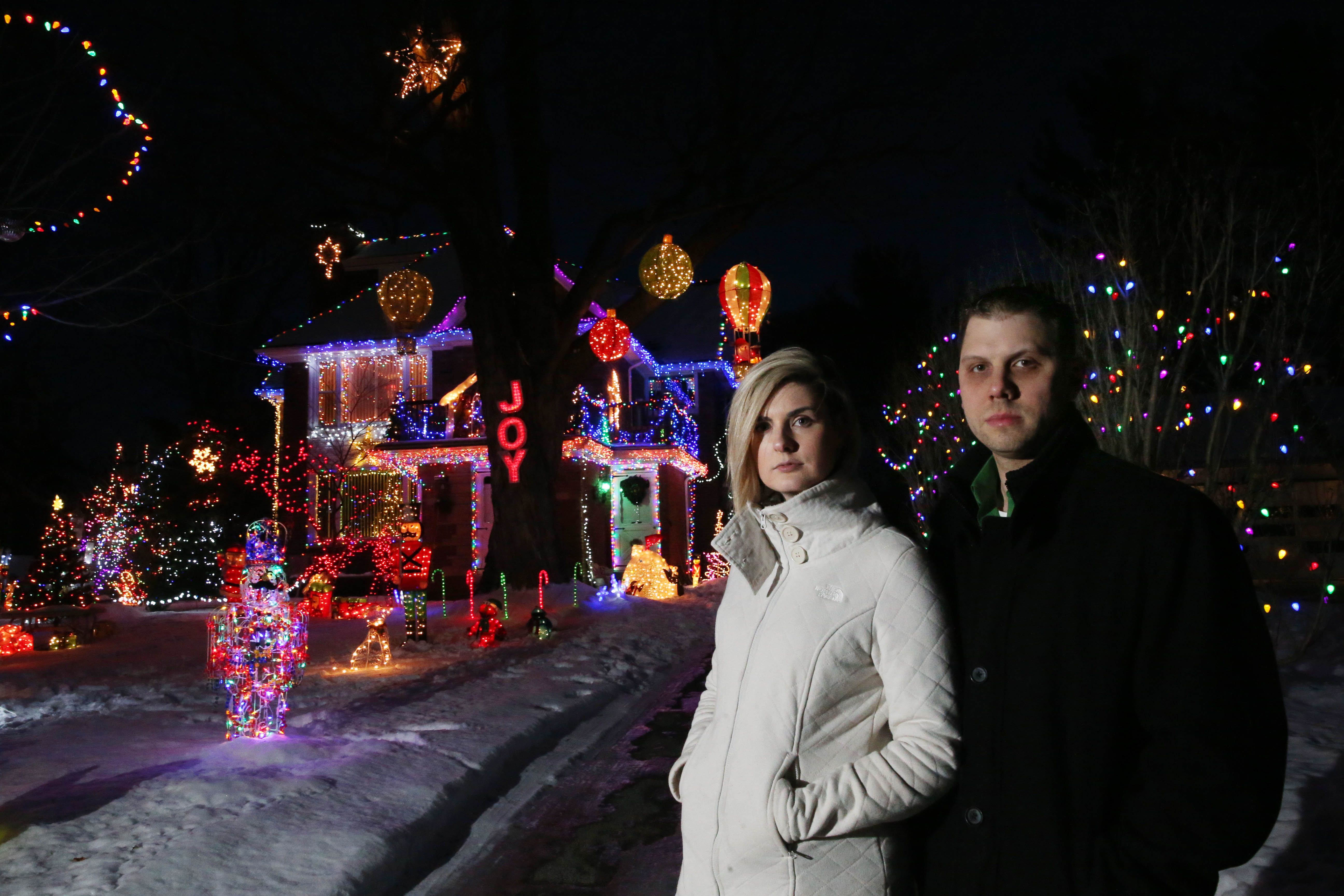 Ken Boris, pictured in the front yard of his Village of Hamburg home with fiancé Samantha Richard, has been carrying on a three-generation tradition of decorating his home for Christmas for 15 years. (Sharon Cantillon/Buffalo News)