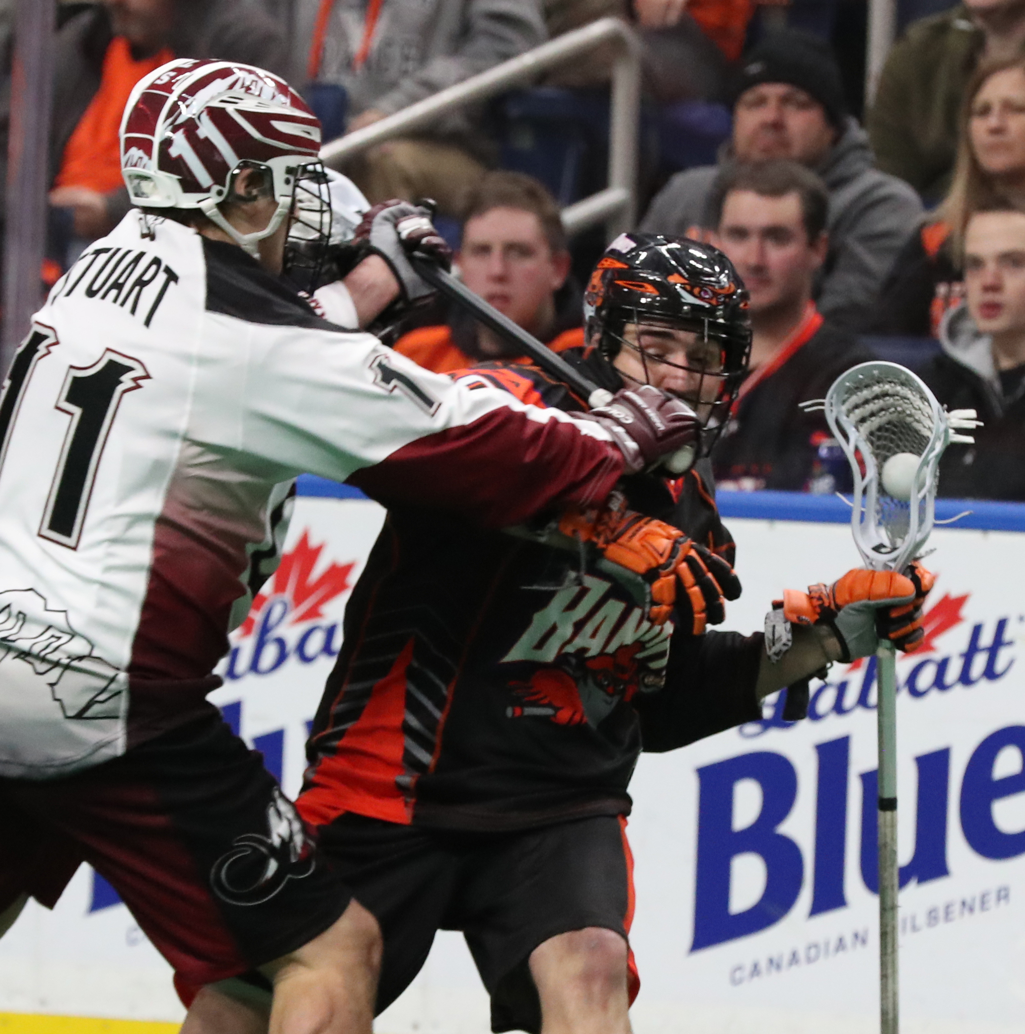 The Bandits' Andrew Watt battles the Mammoth's Taylor Stuart for the ball during Friday's opener.  (James P. McCoy/Buffalo News)