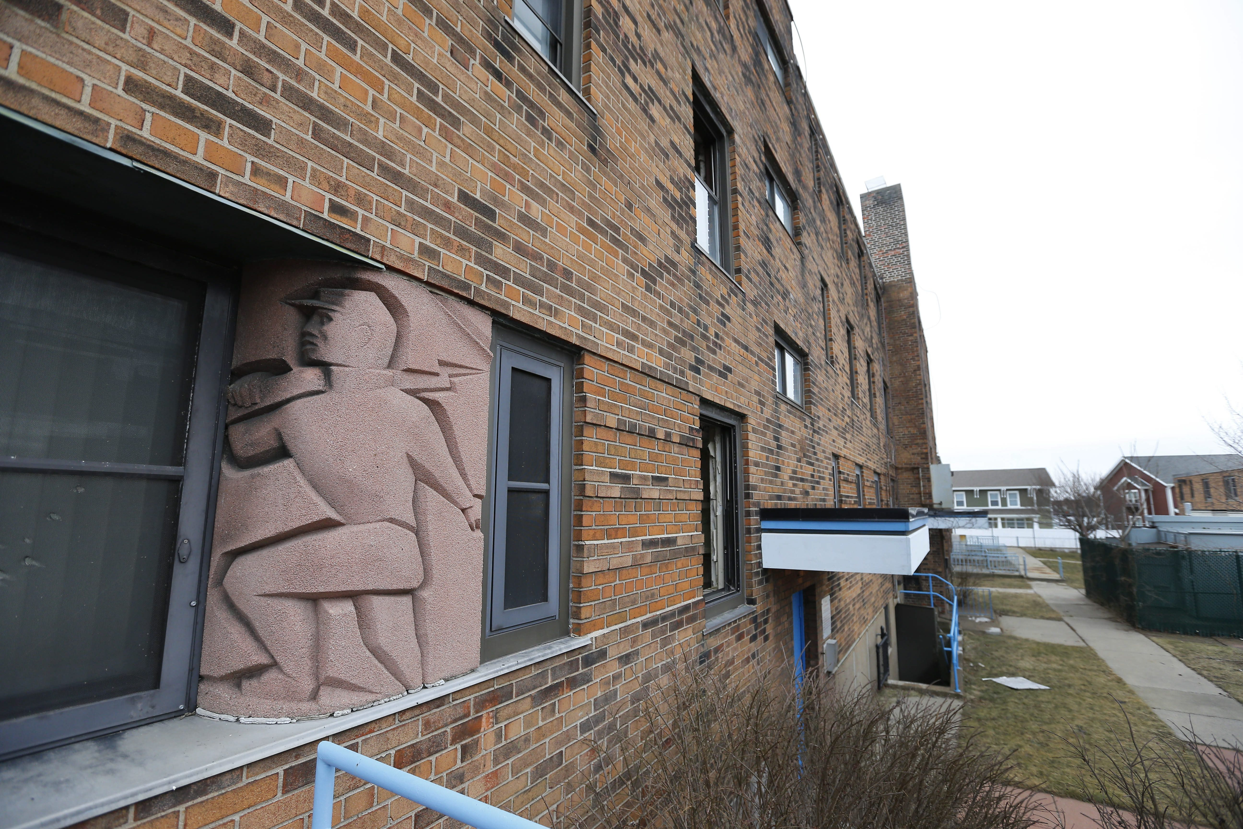 WPA artwork adorns the  the abandoned A.D. Price complex on Mortimer Street in Buffalo Tuesday, March 1, 2016.  The Buffalo Municipal Housing Authority wants to knock down the A.D. Price buildings and replace them with newer housing.  (Mark Mulville/Buffalo News)