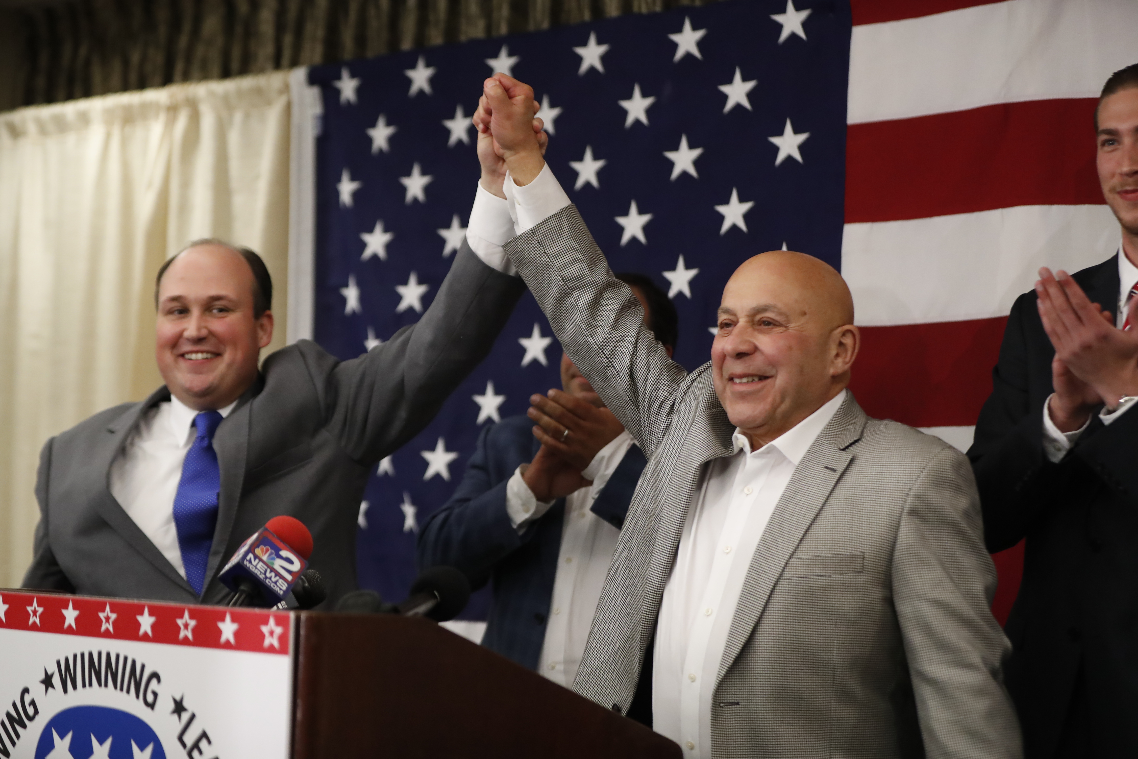 Angelo J. Morinello, on right, speaks after being elected to the State Assembly at Republican headquarters at the Avant Building on Tuesday, Nov. 8, 2016. (Harry Scull Jr./Buffalo News)