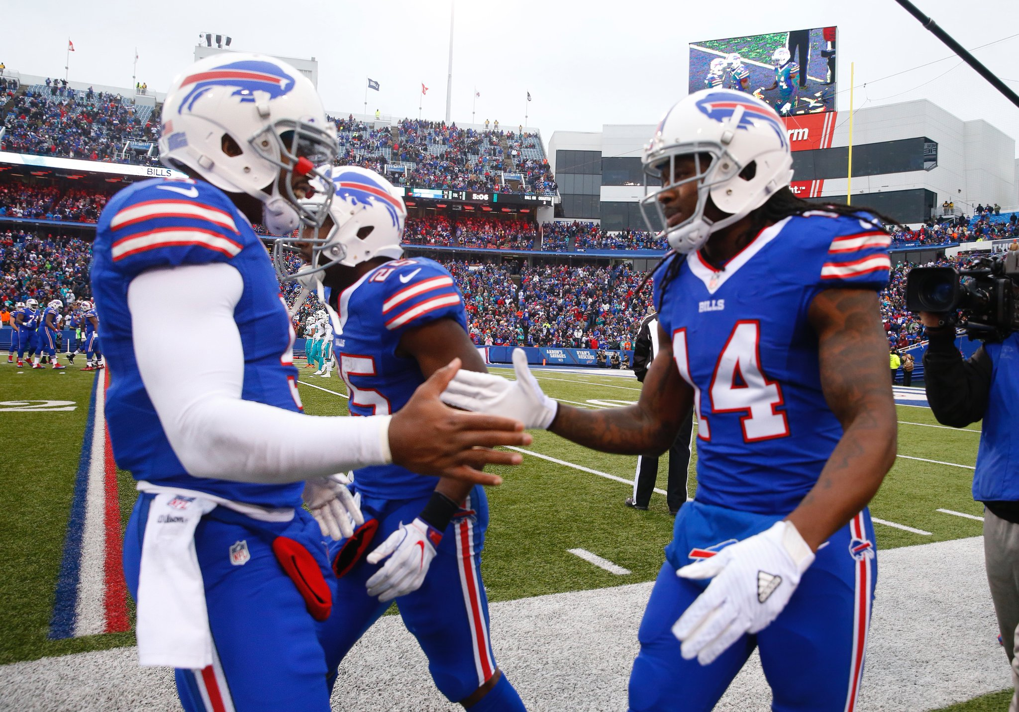 Tyrod Taylor and Sammy Watkins celebrated Watkins' touchdown catch in what was an entertaining game. (Harry Scull Jr./Buffalo News)