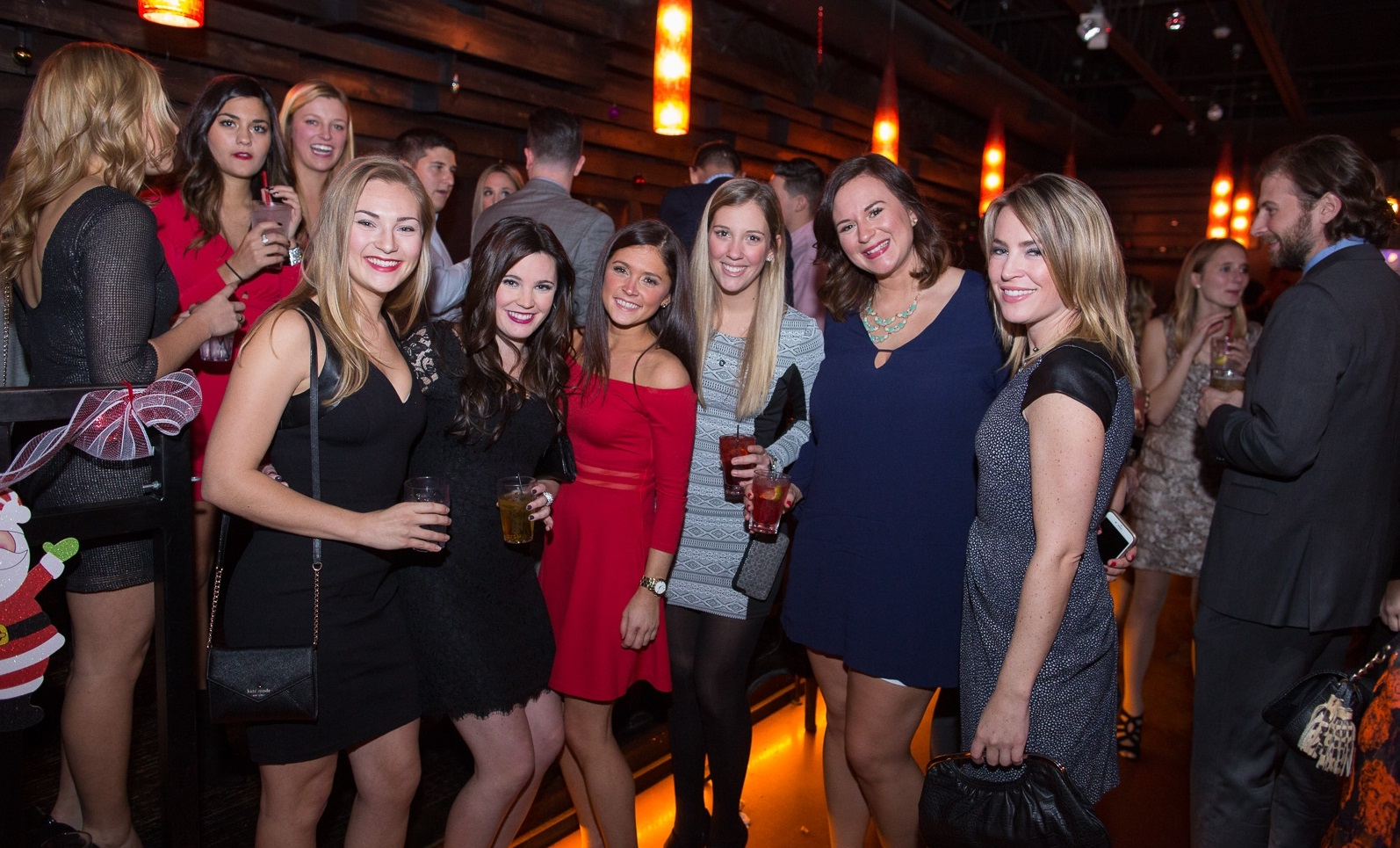 Smiles at the 2015 Carly's Club gift gathering at SoHo Burger Bar. (Chuck Alaimo/Special to The News)