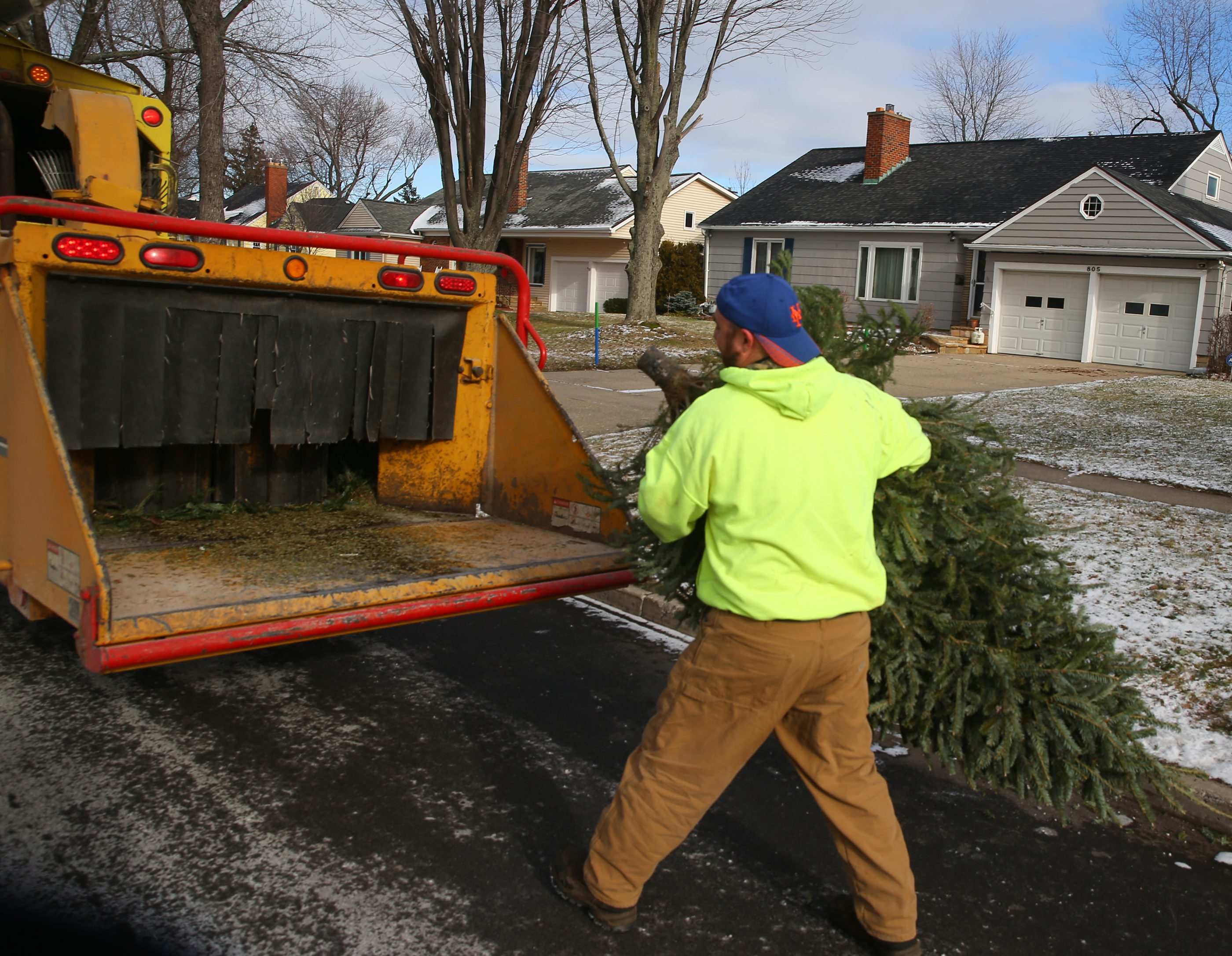 Mike Faraci, a tree trimmer with Town of Tonawanda, helps collect discarded Christmas trees and puts them into a wood chipper in the Town of Tonawanda, N.Y., on Jan. 5, 2016. (John Hickey/Buffalo News)
