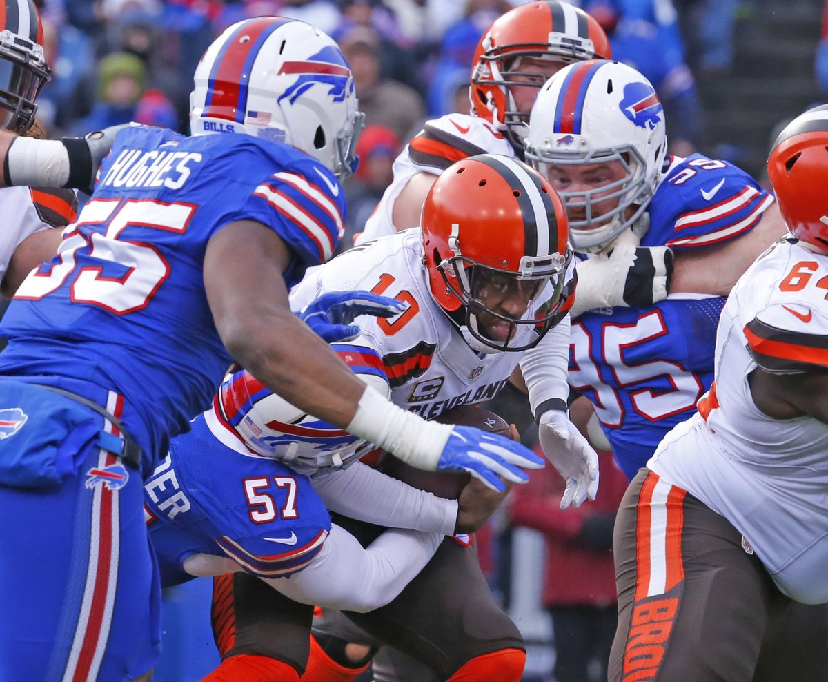 Lorenzo Alexander and Kyle Williams sack Browns quarterback Robert Griffin III. (Harry Scull Jr./Buffalo News)