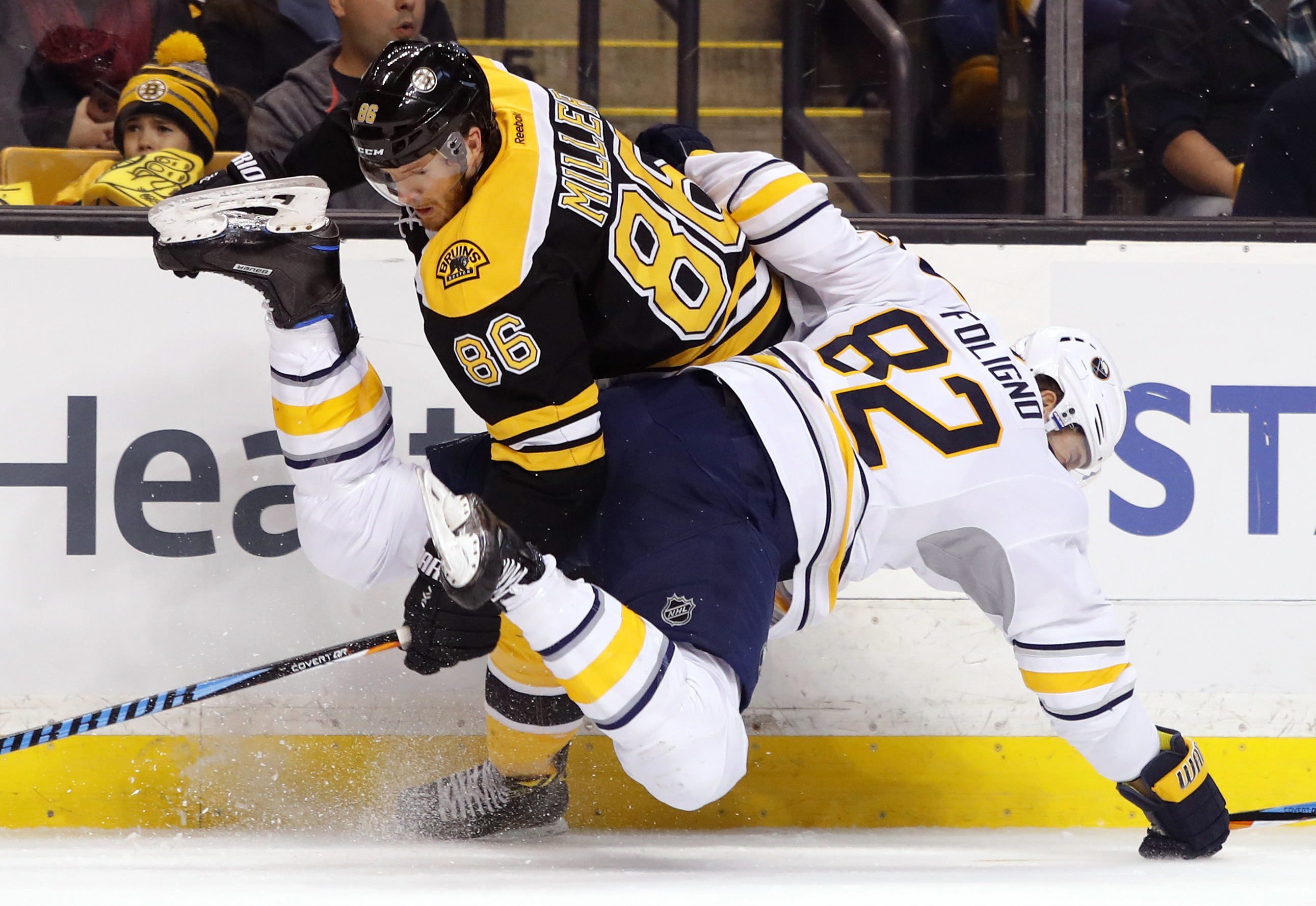 Marcus Foligno is updended by Boston defenseman Kevan Miller (Winslow Townson-USA TODAY Sports)