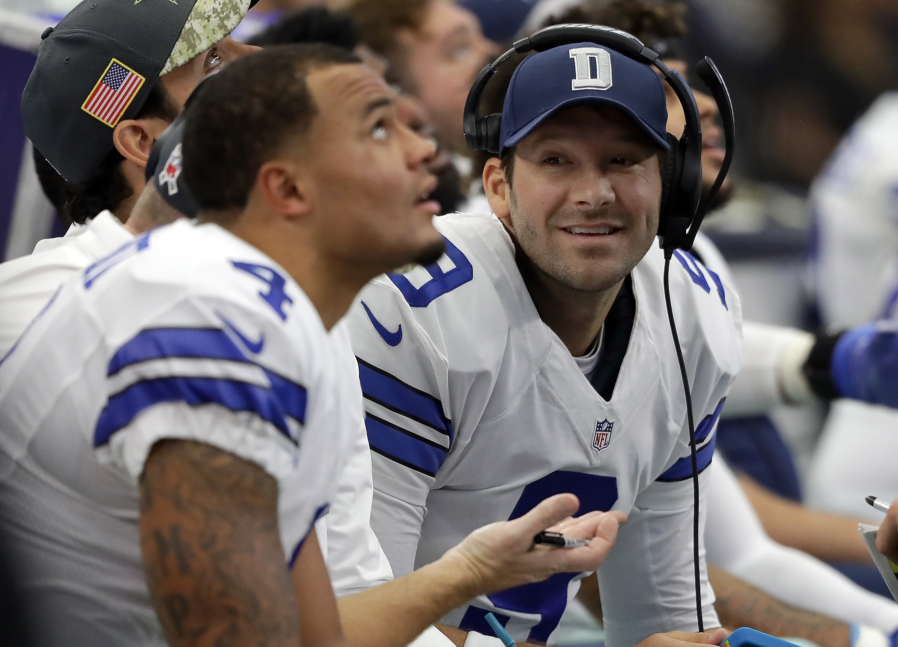 Tony Romo, right, talks with Dak Prescott, foreground, during Dallas' game with Baltimore on Nov. 20. (/Getty Images)