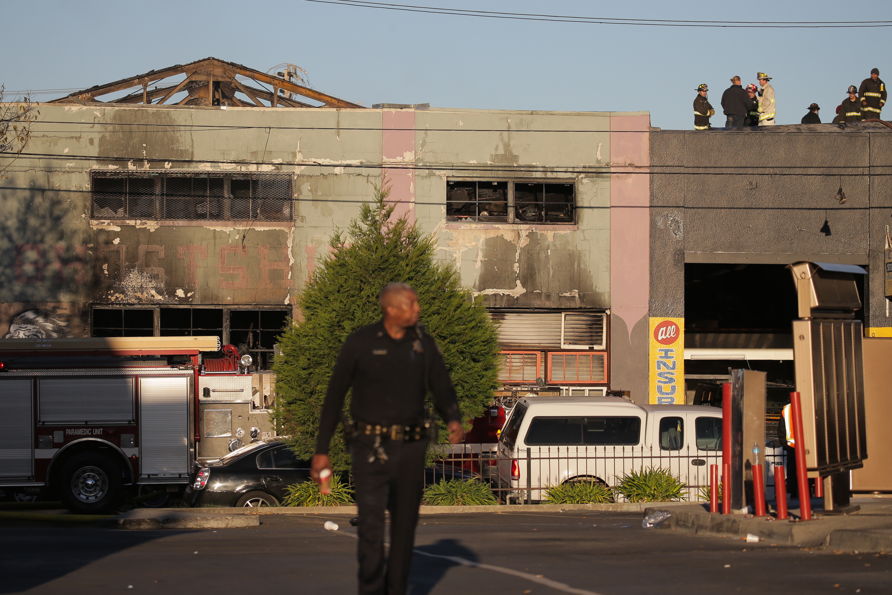 Firefighters and police at the scene of a overnight fire that claimed the lives of at least nine people at a warehouse in the Fruitvale neighborhood on December 3, 2016 in Oakland, California. The warehouse was hosting an electronic music party.  (Getty Images)