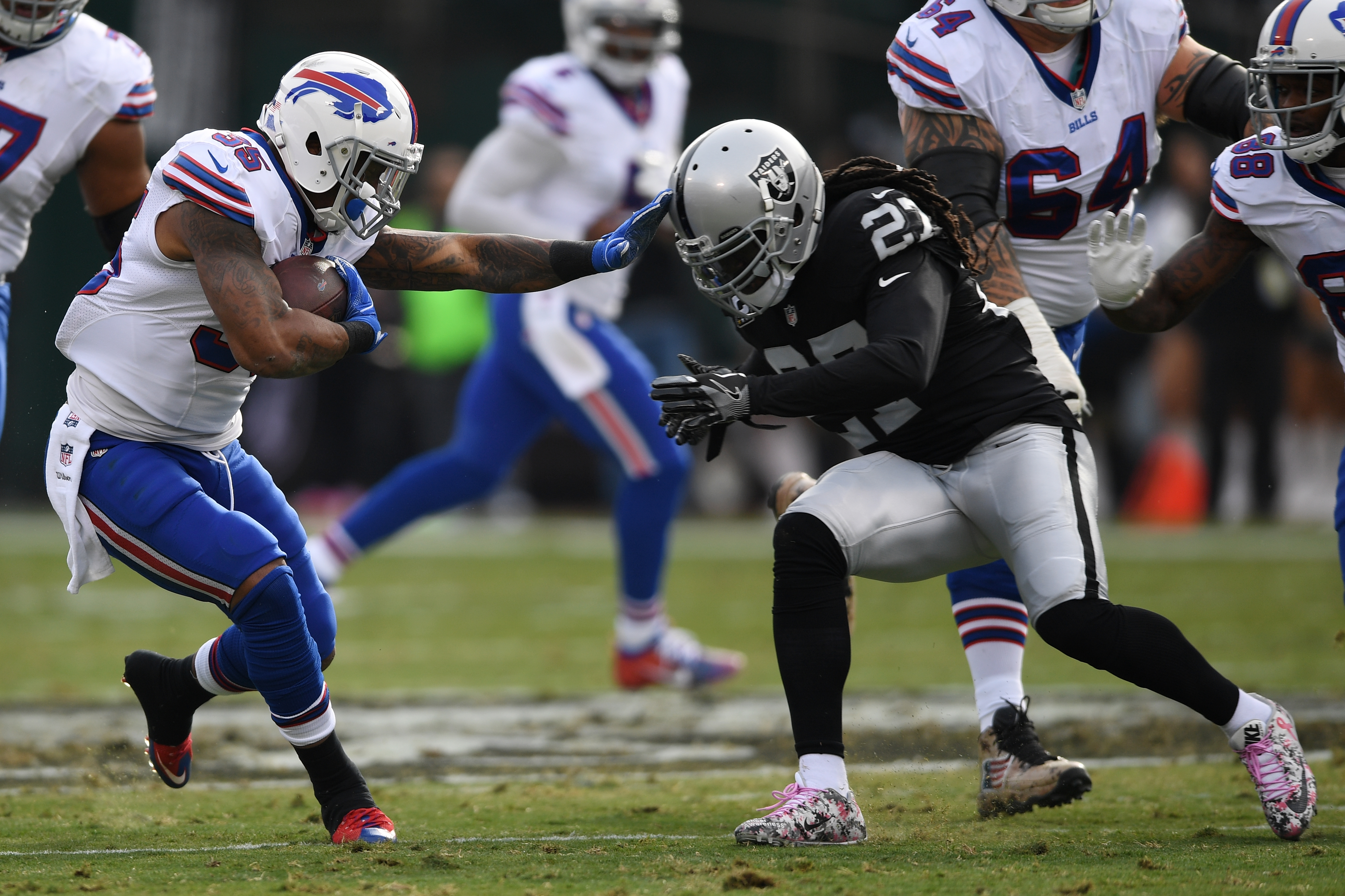 Mike Gillislee of the Buffalo Bills rushes against Reggie Nelson of the Oakland Raiders.  (Getty Images)