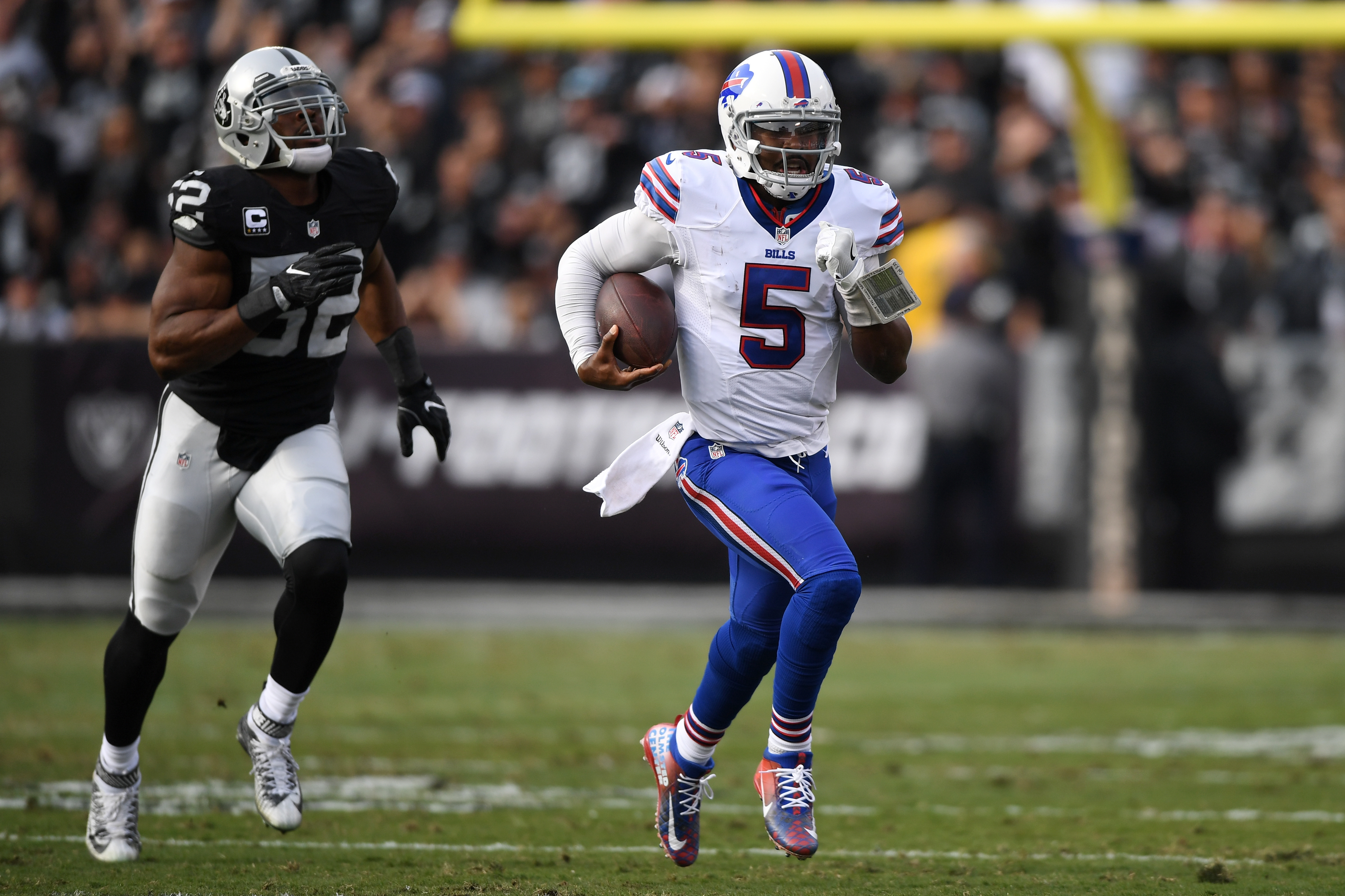 Tyrod Taylor runs as Khalil Mack is in pursuit. (Getty Images)
