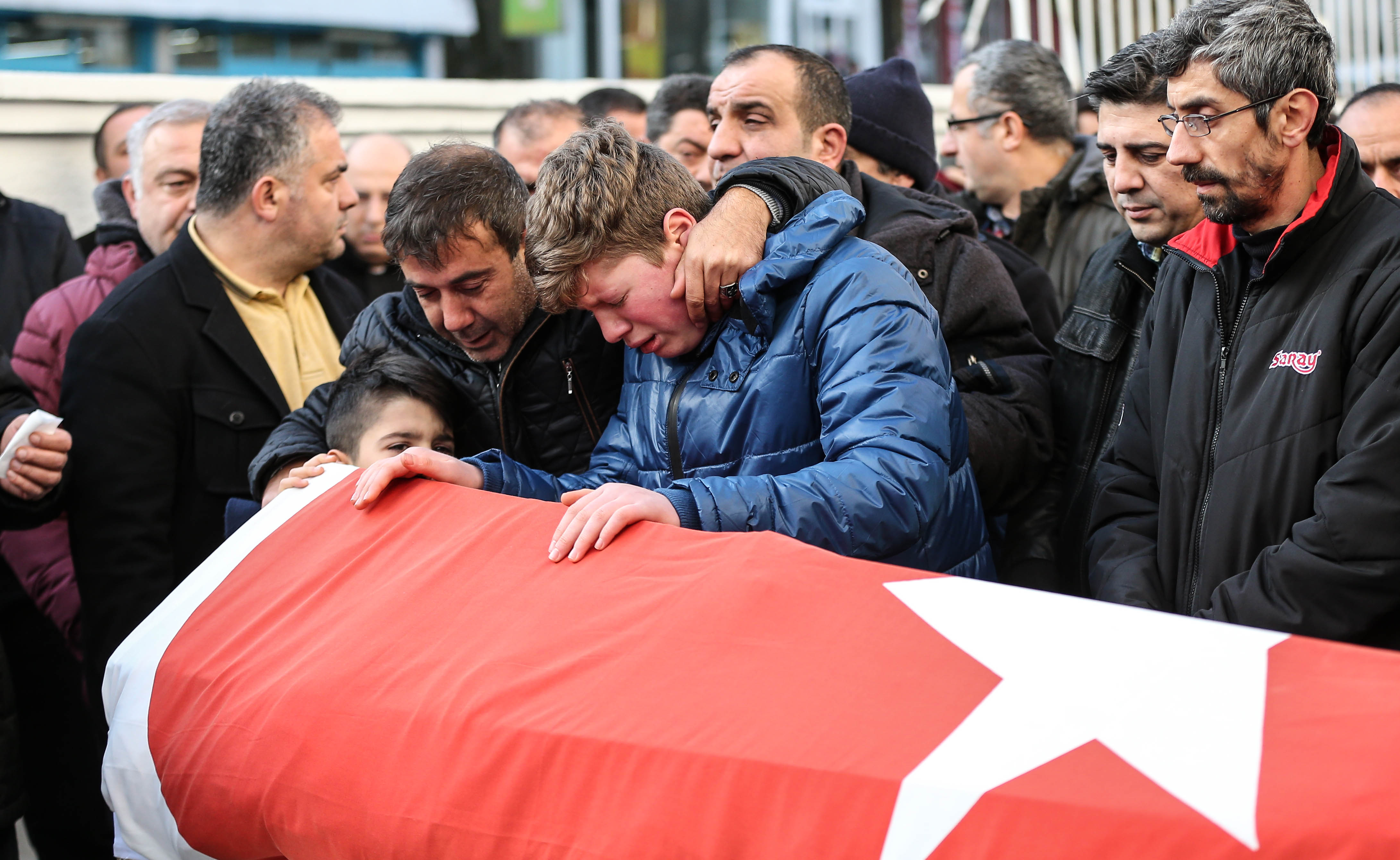 Relatives and friends mourn at a coffin during the funeral of Ayhan Arik, one of the 39 victims of the gun attack on the Reina, a popular night club in Istanbul near by the Bosphorus shores, in Istanbul, January 1, 2017, Turkey. According to Turkey's interior minister Suleyman Soylu at least 39 people, including at least 15 foreigners have been killed dead and 40 wounded at terror attack at Istanbul's famous night club of Reina in Bosphorus shores in the new year party.  (Photo by Burak Kara/Getty Images)