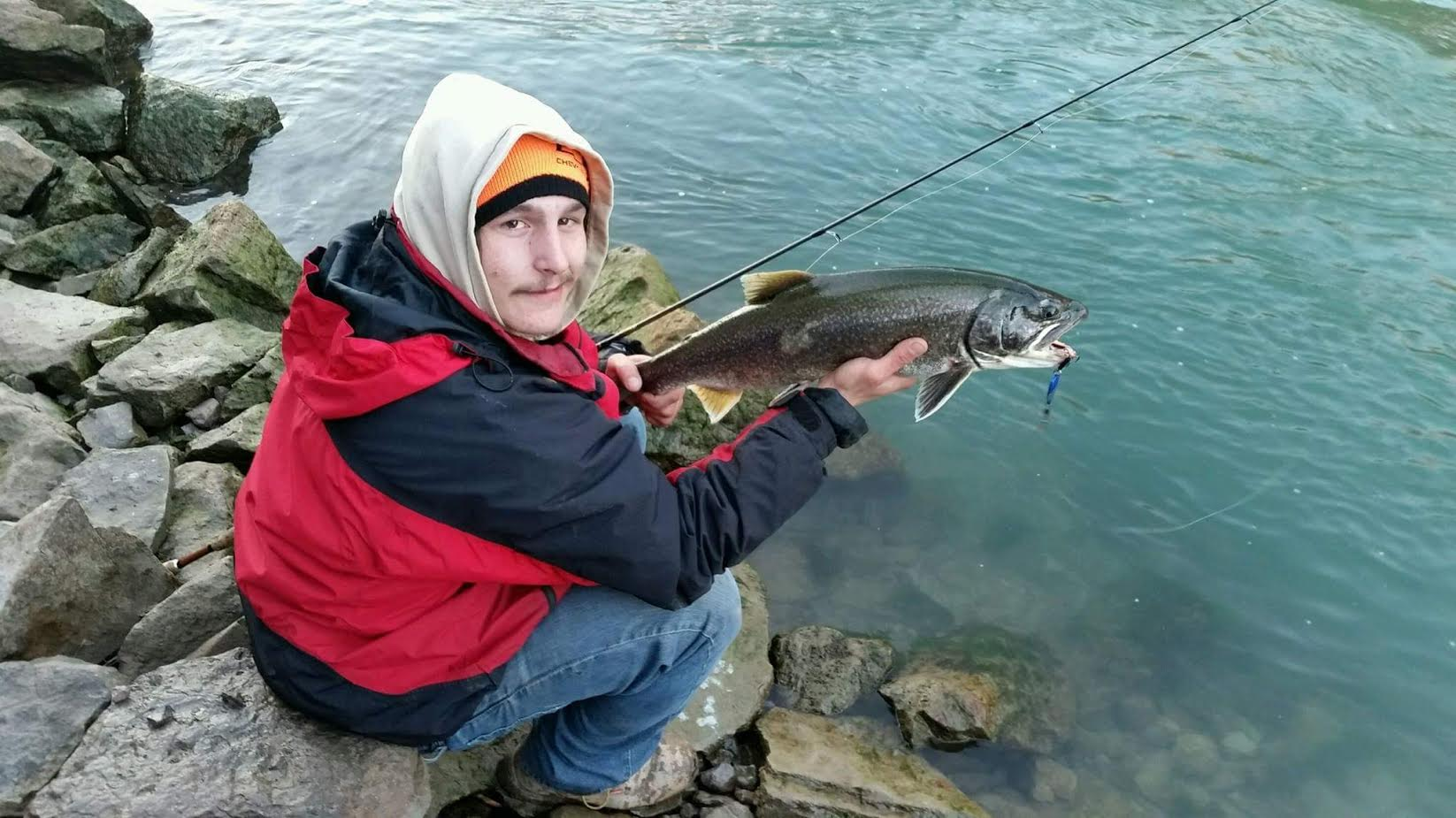 Glenn Strzelczyk of the Town of Niagara gets ready to release a lake trout in the lower Niagara River after catching it on a spinner. Lake trout season opens on Jan. 1 in the lower river. It is open all year in the upper Niagara.