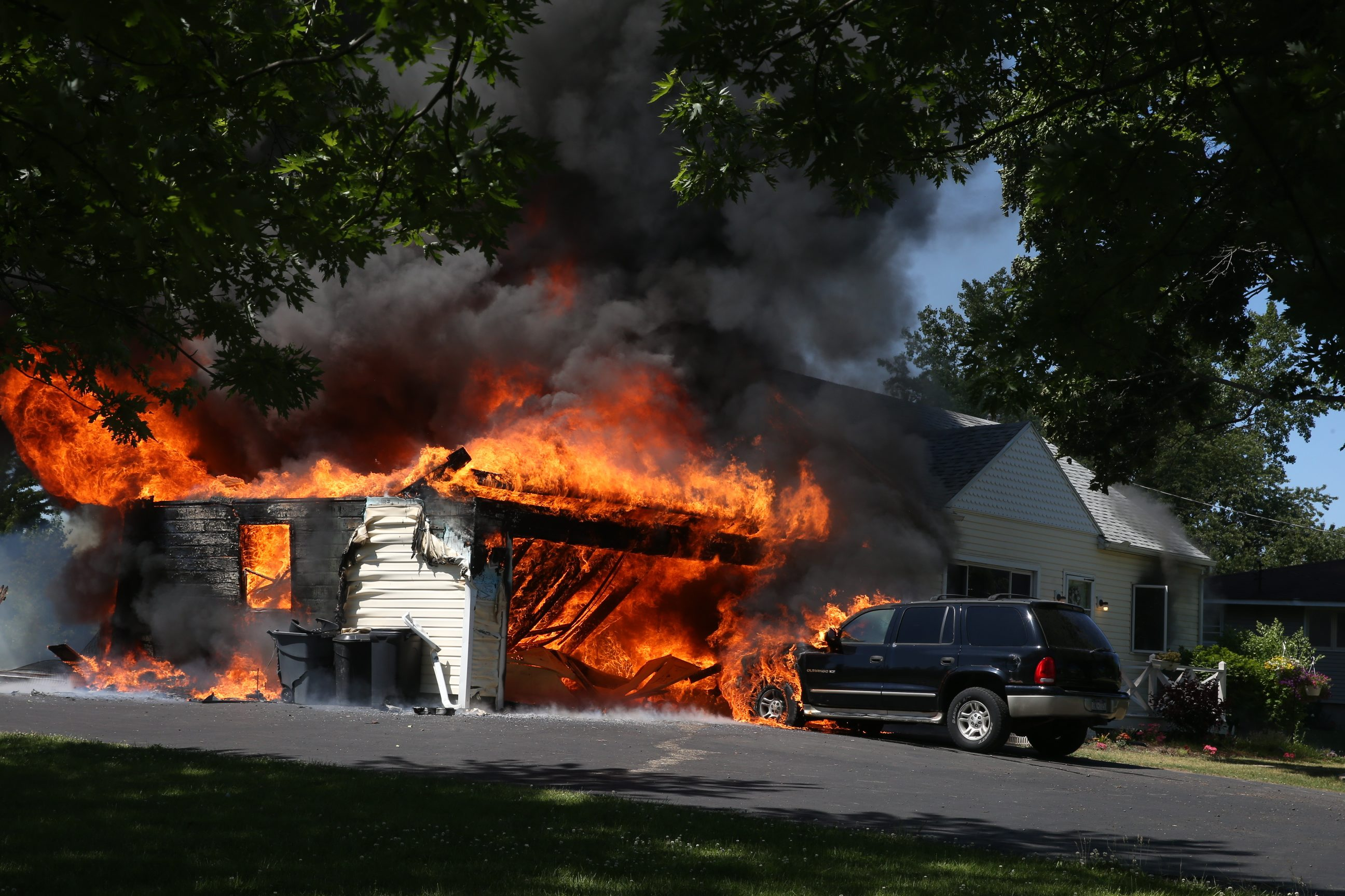 A garage fire that spread to attached home at 6108 Strauss, in Lockport, N.Y., on Friday June 17, 2016.  (John Hickey/Buffalo News)