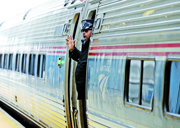 Amtrak conductor S. Johnson, of Albany, calls 'all-aboard' for the first departure from the new Amtrak Rail Station in  Niagara Falls, N.Y., on  Tuesday, Dec. 6, 2016.  (Robert Kirkham/Buffalo News)