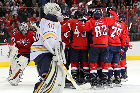 A disconsolate Robin Lehner heads off the ice as the Caps celebrate Marcus Johansson's overtime winner Monday night (Getty Images).