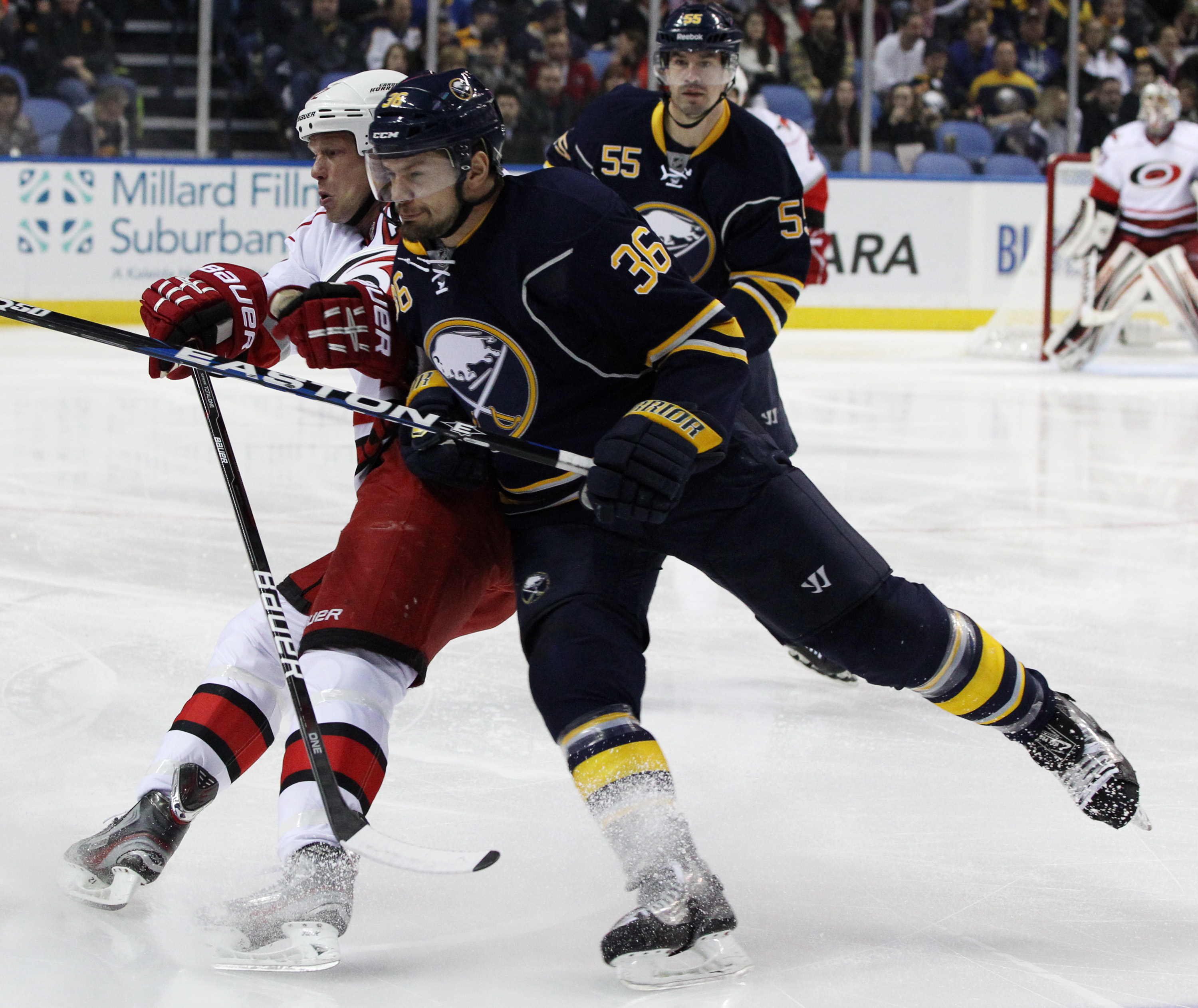Then-Buffalo Sabres right wing Patrick Kaleta (36) hits Carolina Hurricanes center Eric Staal (12) at  First Niagara Center in Buffalo on Jan. 25, 2013.  Kaleta is part of the Kaleta Group that now plans to build a multisport recreation center with two ice rinks in Hamburg. {File photo by James P. McCoy / Buffalo News}
