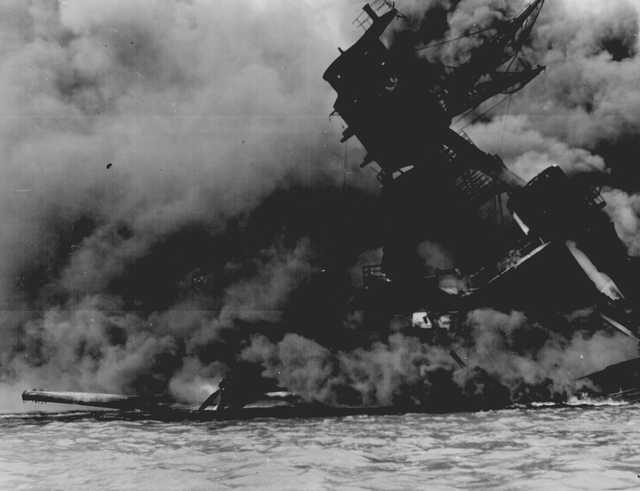 The USS Arizona burns after the Japanese attack on Pearl Harbor, 75 years ago. National Archives and Records Administration