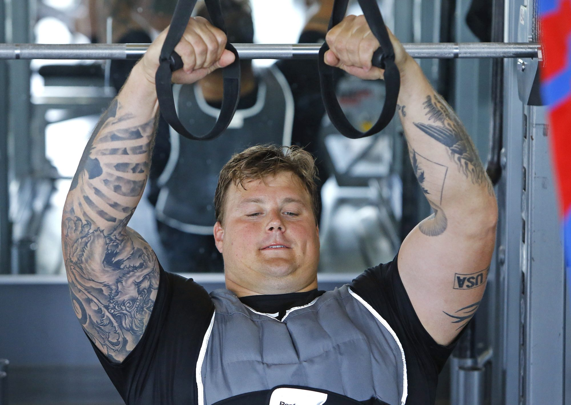Buffalo Bills guard Richie Incognito works out with other athletes Thursday, March 3, 2016 at Exos in Phoenix, Ariz.