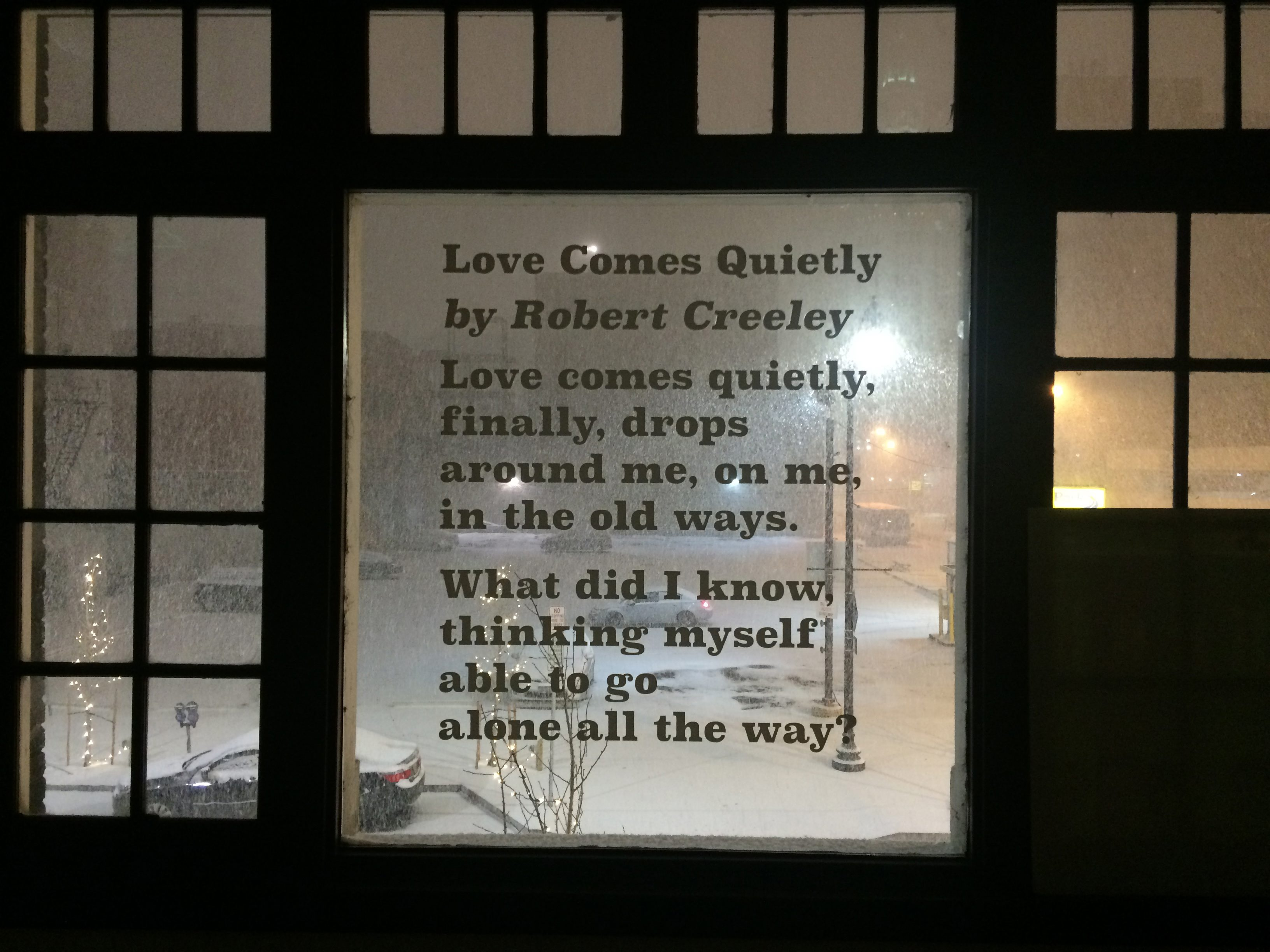A poem by Robert Creeley hangs in the window of the Just Buffalo Literary Center, which received a $70,000 grant from the National Endowment for the Arts to fund a community literature and gardening project.
