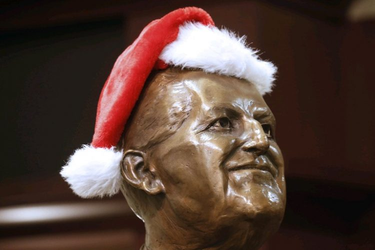 A bust of Ernest Notar, a founder of Niagara County Community College, was in the holiday spirit on Old Falls Street in Niagara Falls. Forecasts show the first white Christmas in Buffalo since 2013 is likely this year. (Robert Kirkham/Buffalo News)