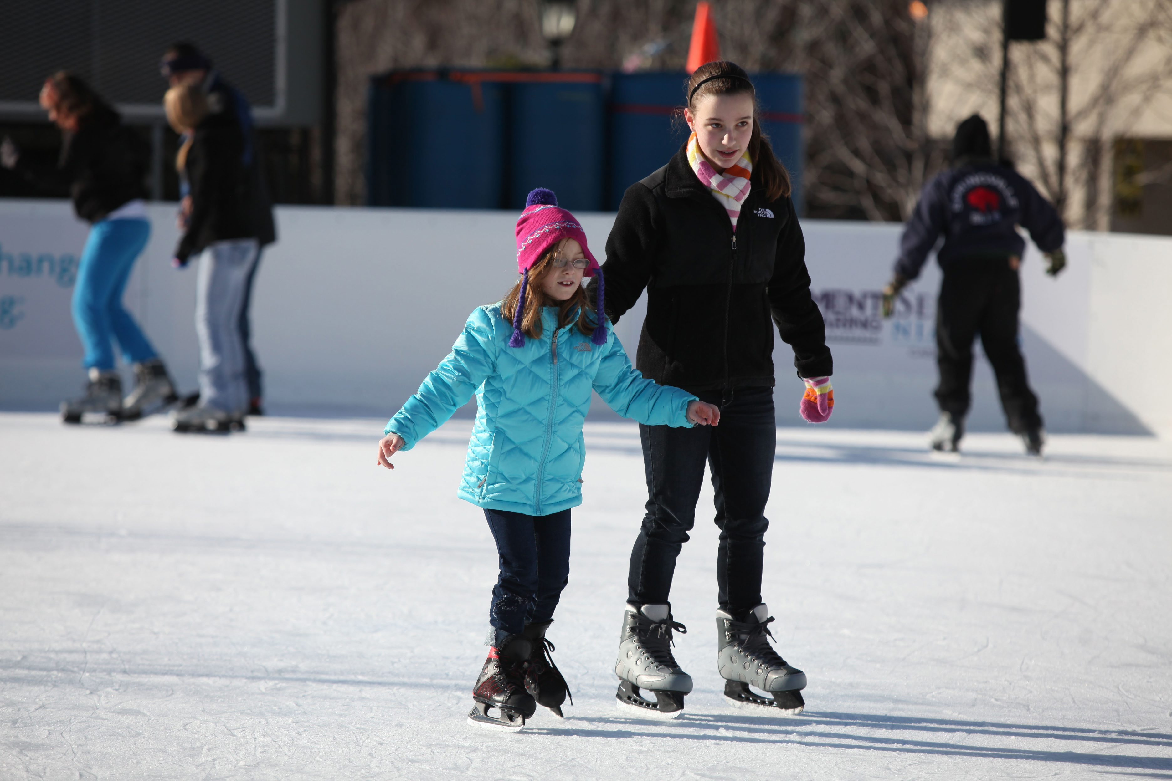 Sisters Mackenzie, 6, left, and Samantha Leone, 14, enjoy ice skating at the Niagara Holiday Market on Old Falls Street in Niagara Falls in this file photo from Dec. 26, 2011. {Charles Lewis / Buffalo News}