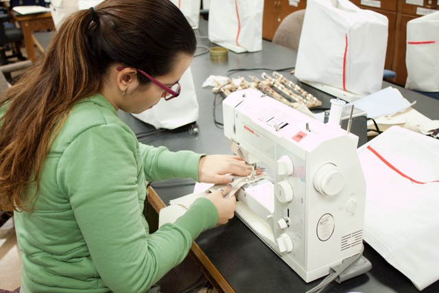 Niagara University student Sonia Angeli sews a 1770s British 8th Regiment waistcoat for the Old Fort Niagara fife and drum corps as part of a costume construction class offered through the NU theatre and fine arts department. (Provided by Niagara University)