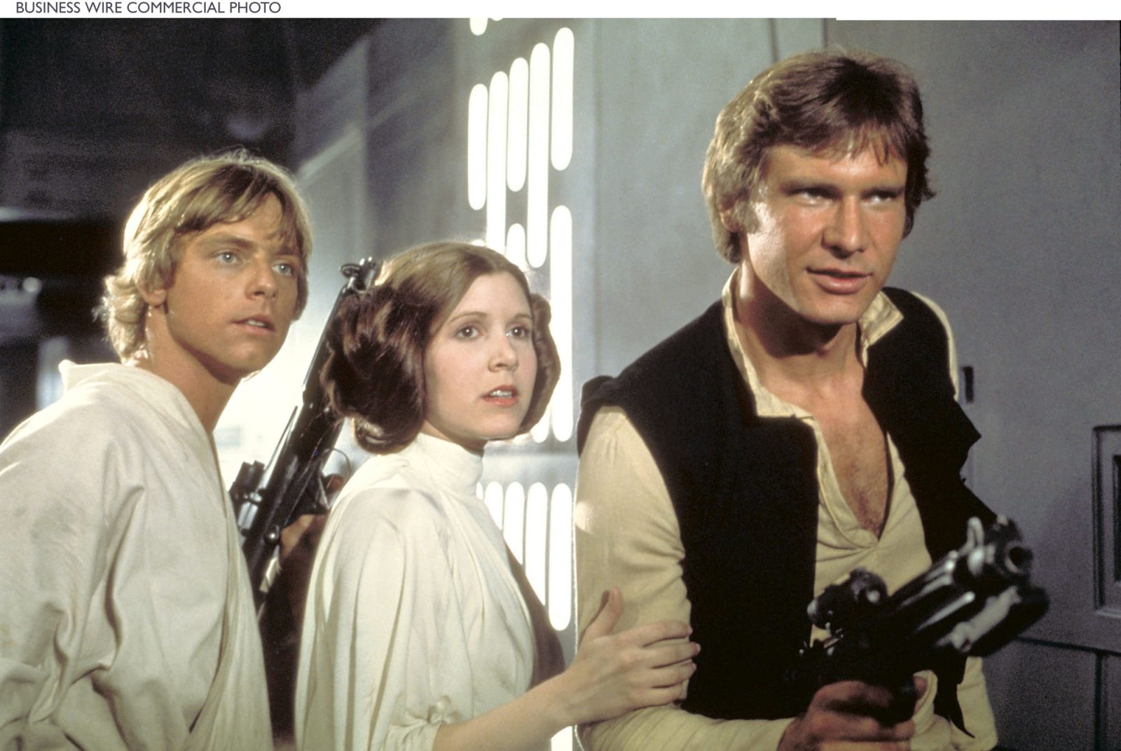 Carrie Fisher with Mark Hamill and Harrison Ford in 'Star Wars,' the film that made all of them movie icons.  (Courtesy of Lucasfilm Ltd.)