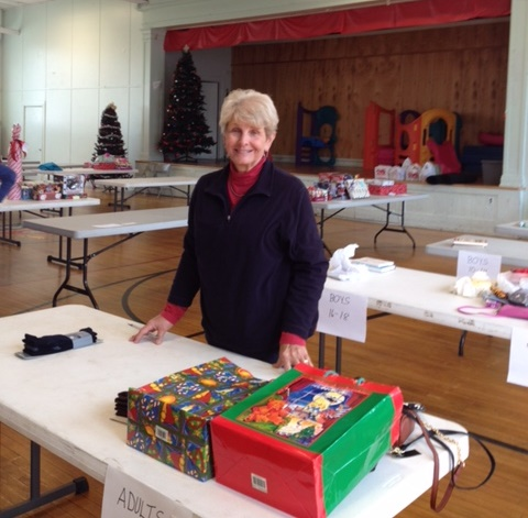 One of the volunteers, Janet Brooks, wraps presents for the  Youngstown Christmas Basket project during December, 2015 in the Red Brick building in  Youngstown, N.Y. (Provided photo)