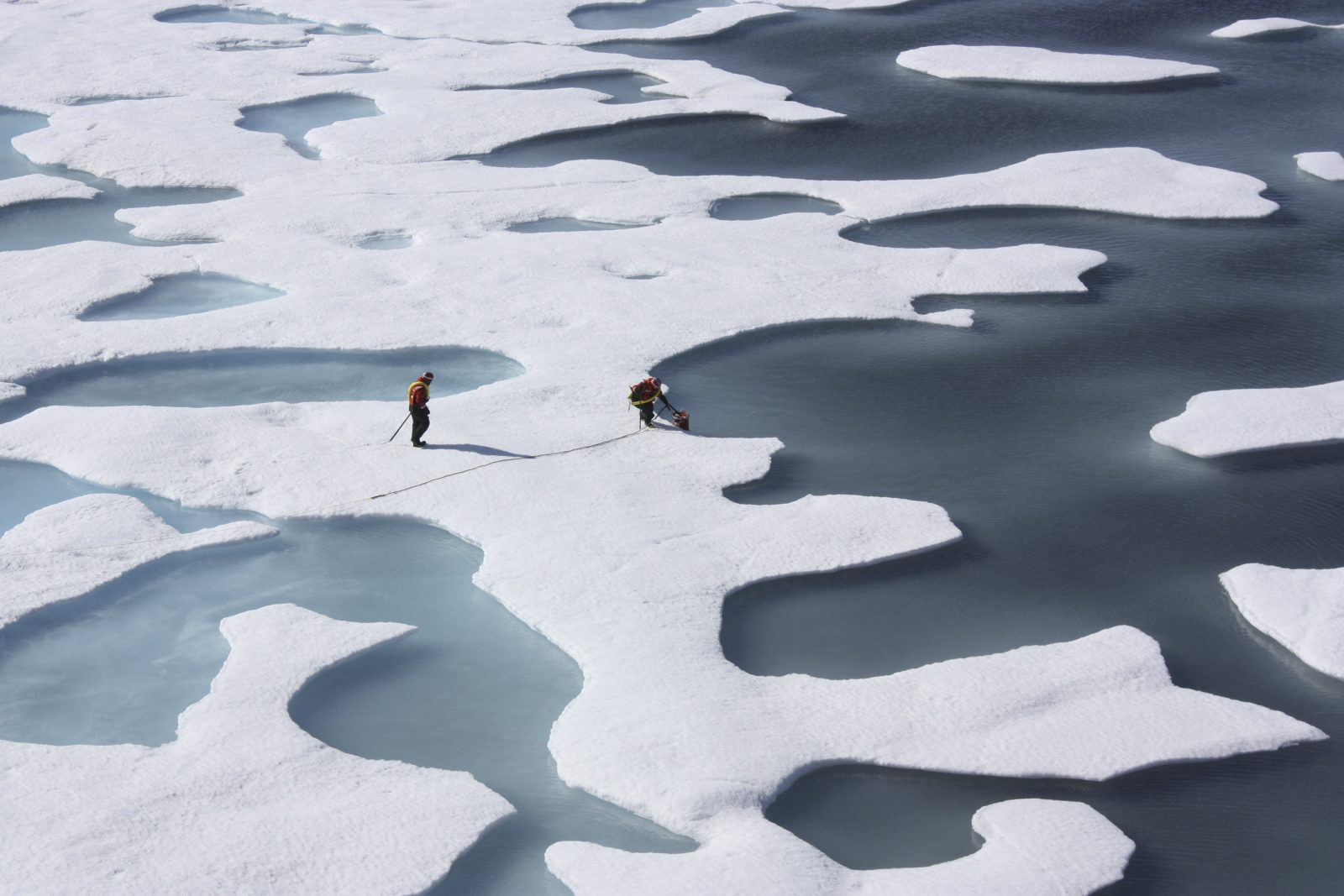 Crewmembers with the U.S. Coast Guard Cutter Healy retrieve supplies during their ICESCAPE Mission in the Arctic Ocean, July 12, 2011. (NASA via The New York Times)