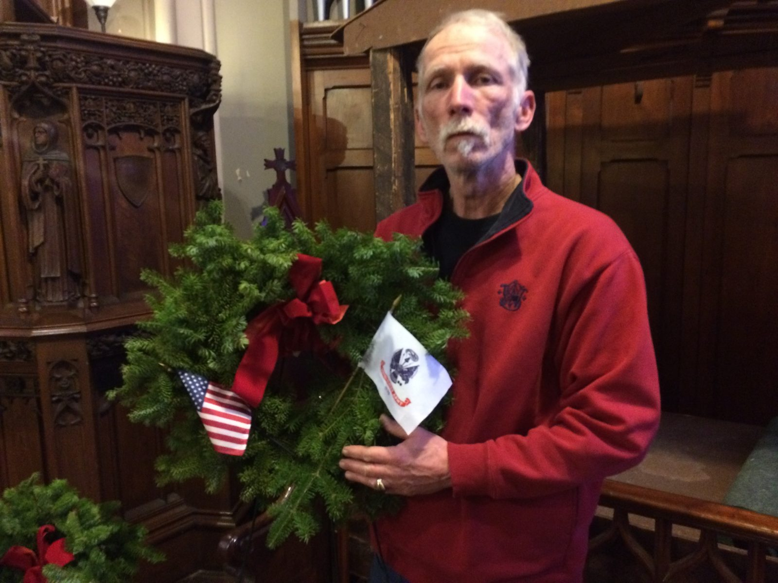 Jim Buschman, supervisor of Soule Cemetery, in Cayuga  County, with a wreath honoring Lt. Robert Buffum, a Civil War Medal of Honor recipient. The discovery of more than 100 sets of human remains in an Auburn yard has left the whereabouts of Buffum's remains a mystery. (Sean Kirst/submitted image)