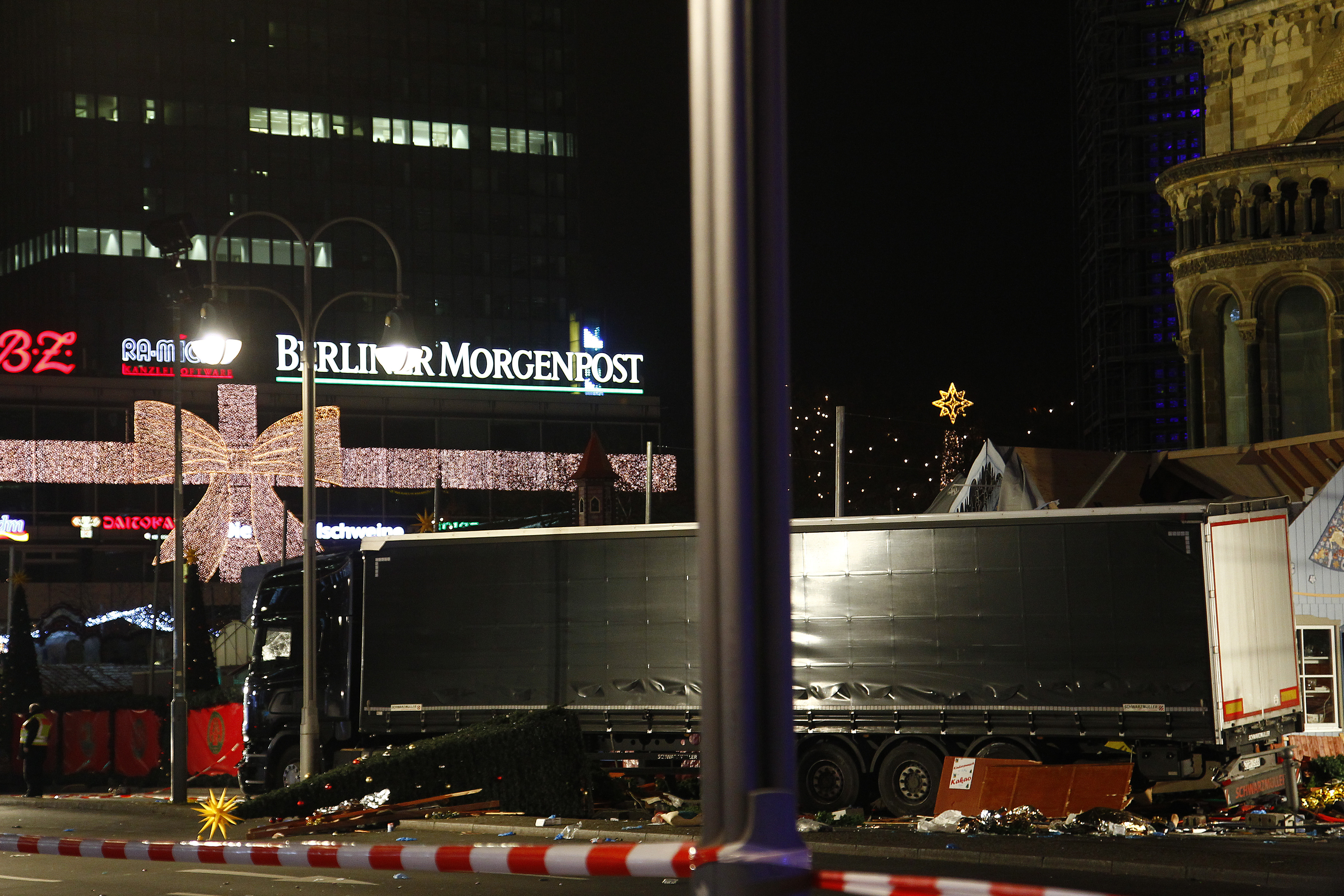 Security and rescue workers tend to the area after a truck plowed through a Christmas market on Dec. 19, 2016 in Berlin, Germany, killing at least nine and injuring many more. (Getty Images)