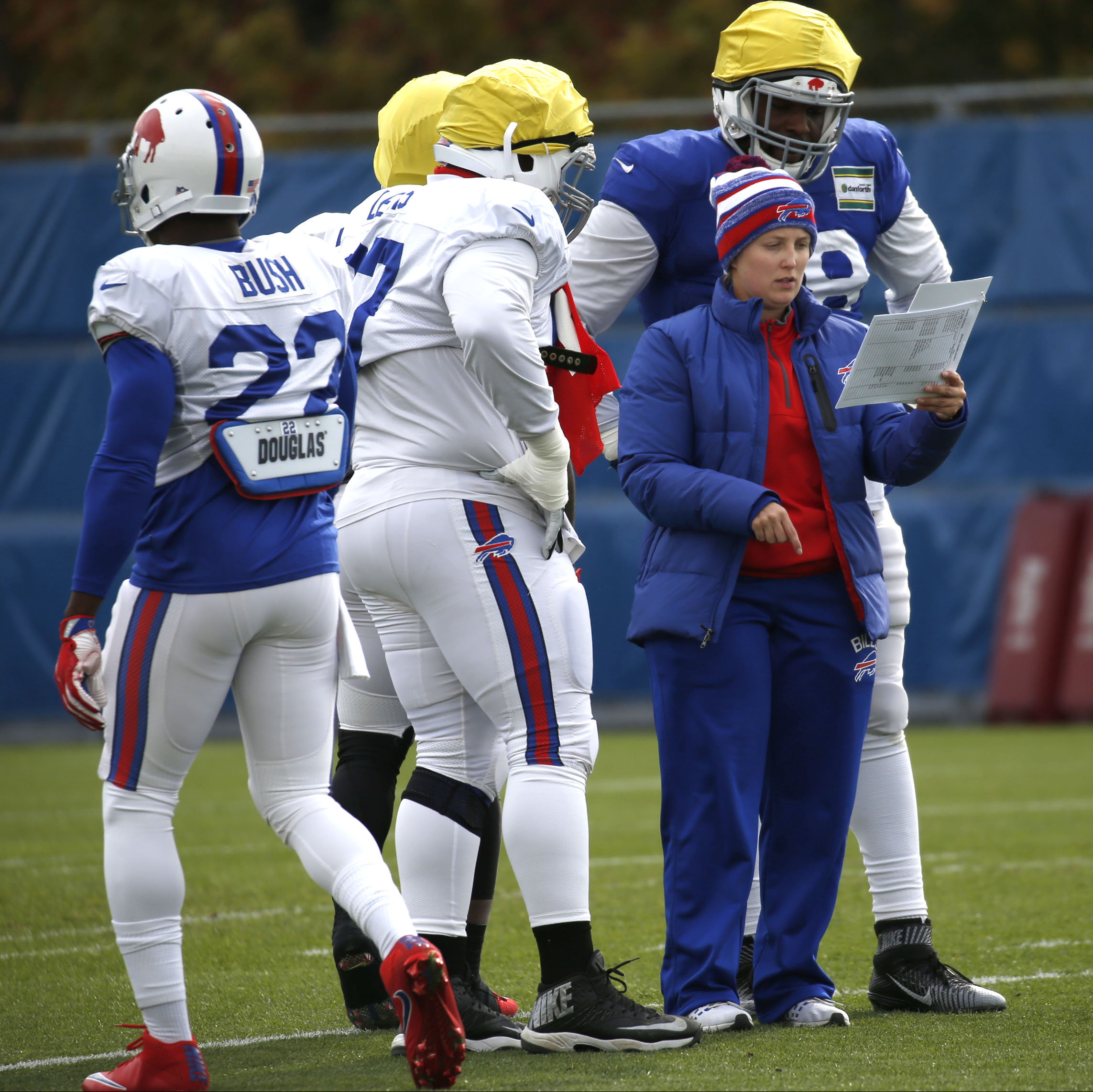 Kathryn Smith, the NFL's first female full-time assistant, is praised by the Bills players for her knowledge and work ethic. (Robert Kirkham/Buffalo News)