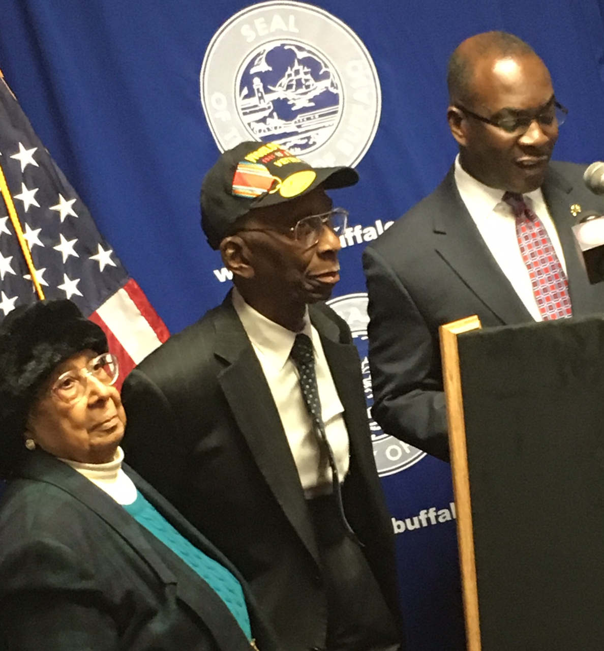 Larusha Blakely, left, standing next her husband, Charles P. Blakely Sr., a WWII  veteran honored Wednesday by Mayor Brown
