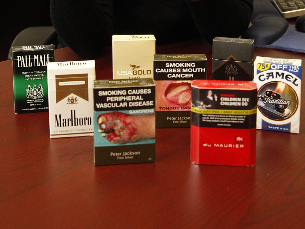 Cigarette boxes in other countries provide a more accurate image of what tobacco smoke can do. (Sharon Cantillon/Buffalo News file photo)