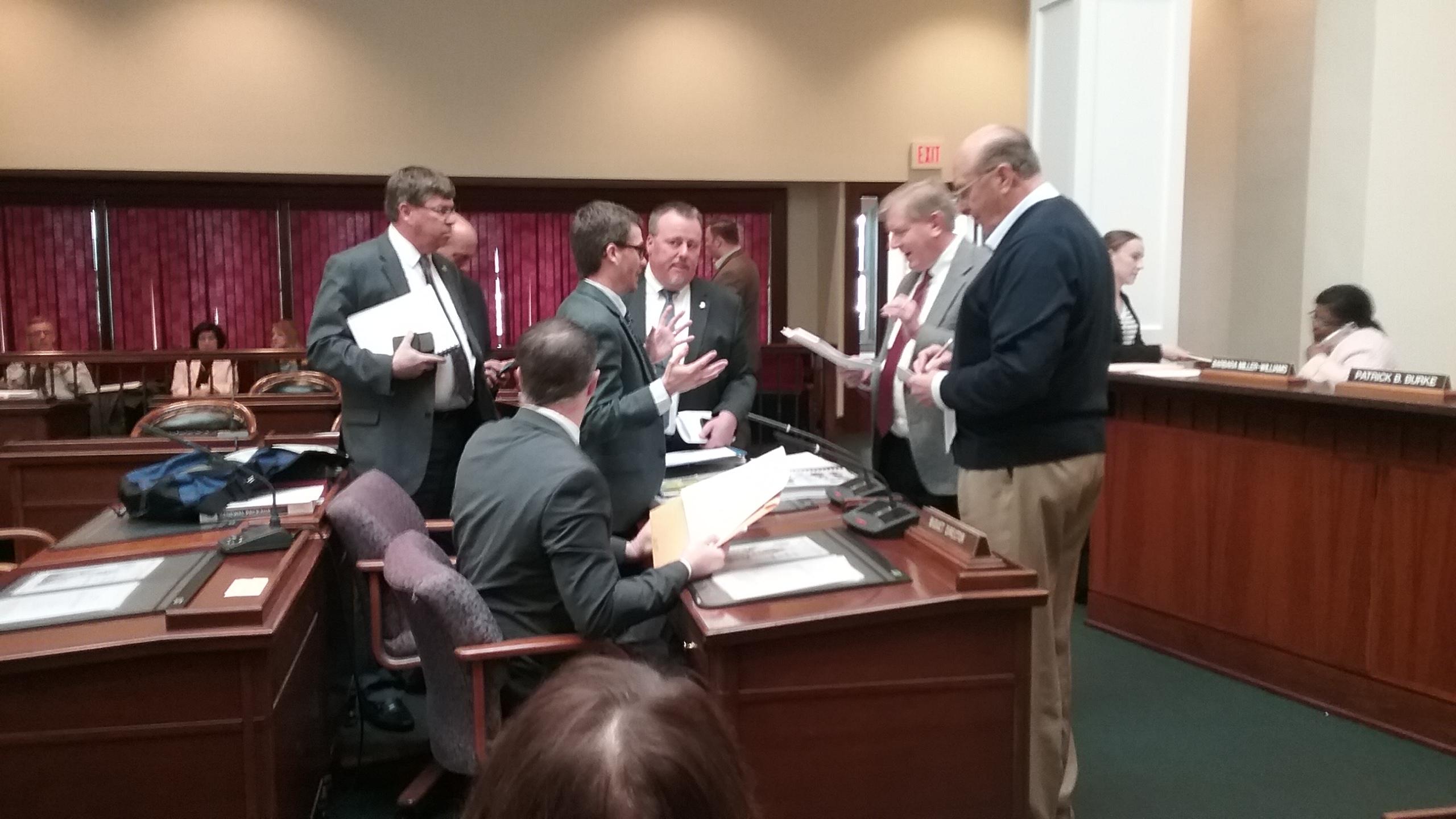 Deputy Budget Director Timothy Callan speaks with Legislator Kevin Hardwick after a  comptroller's hearing before Erie County Legislature in November 2016. (Sandra Tan/Buffalo News)