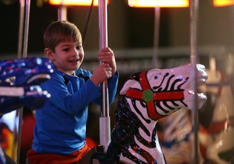 Kristian Jusko Jr., then 5, enjoys the carousel during last year's First Night Buffalo. (Sharon Cantillon/Buffalo News)