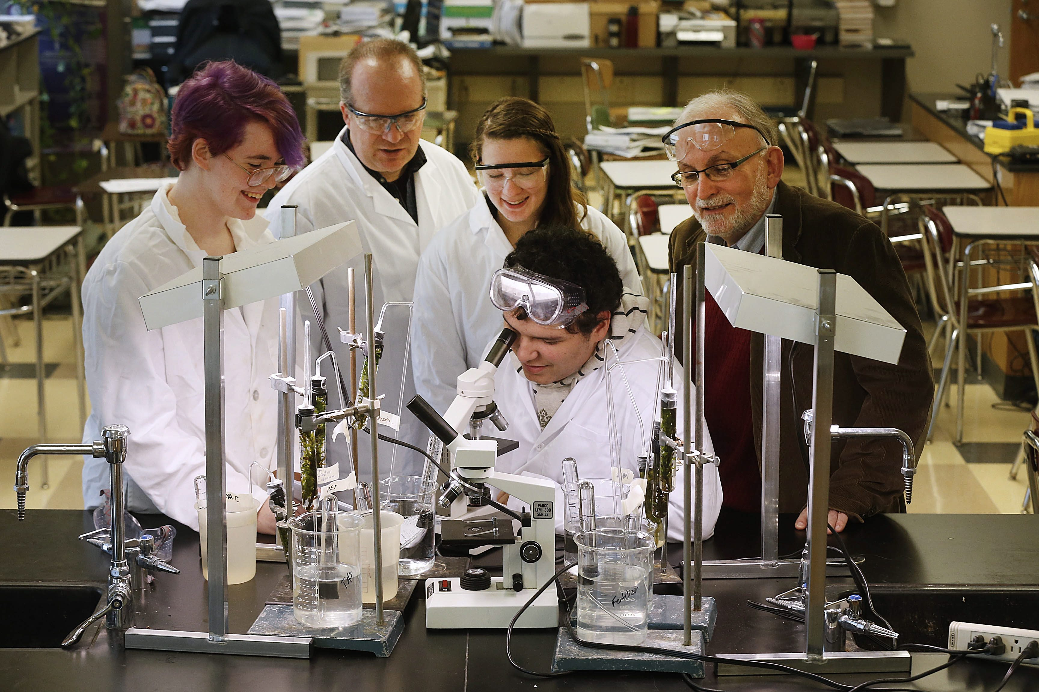 UB professor Joseph Gardella, right, spearheaded the city schools' STEM effort. Here he watches South Park High students conduct an experiment in photosynthesis. At the microscope is junior Anthony Colon. With him are, from left, senior Emily Grant, chemistry teacher Daniel Hildreth and junior Madison Parker. (Robert Kirkham/Buffalo News file photo)