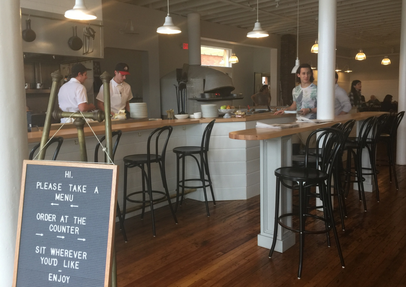 At breakfast and lunch, customers order at the counter and find a seat at Grange Community Kitchen. (Andrew Galarneau/Buffalo News)