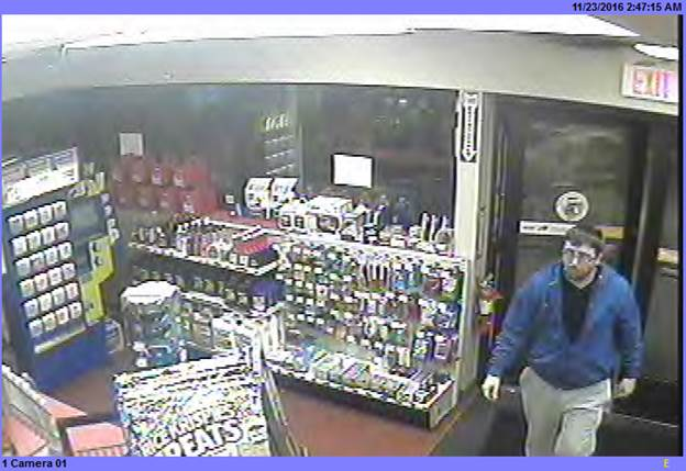 Investigators want to speak with the man in this security image regarding a case of counterfeit currency. (Town of Tonawanda police)