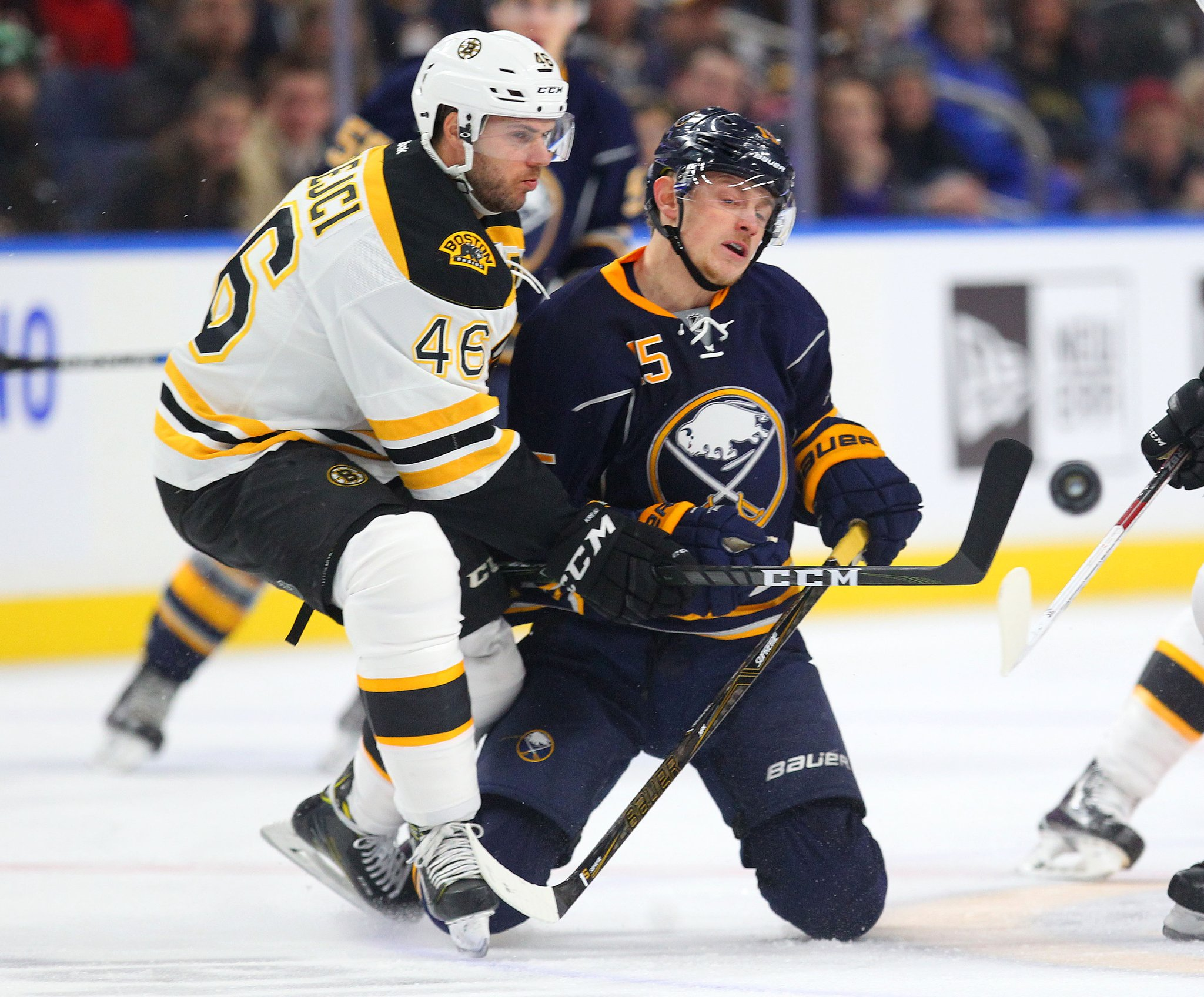 Boston's David Krejci and the Sabres' Jack Eichel jockey for the puck Saturday. (Photo by Mark Mulville/Buffalo News)