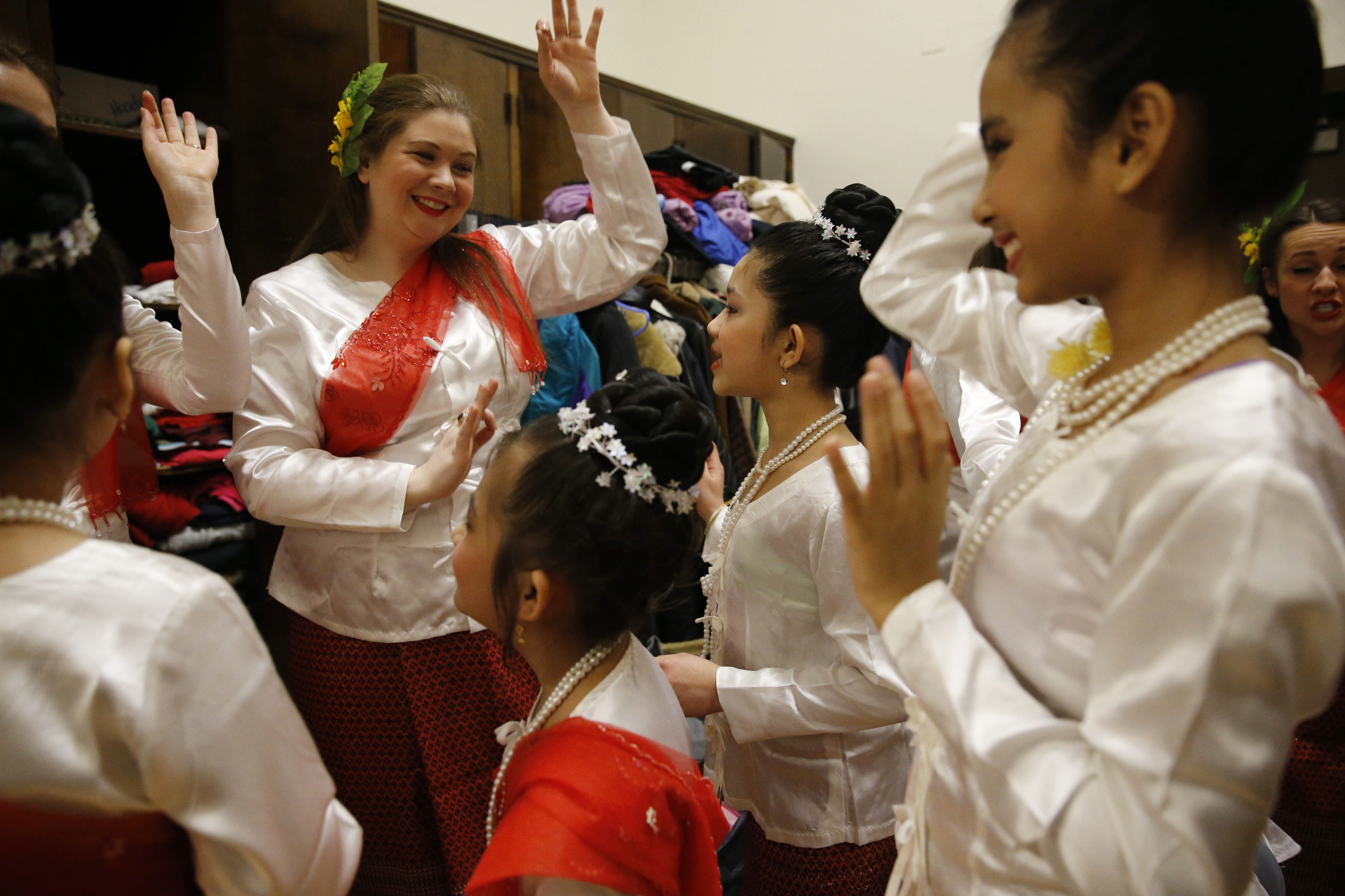 Teacher Kelly Cooper danced with young Burmese refugees on Mon National Day celebrations last Feb. 28. (Derek Gee/Buffalo News)