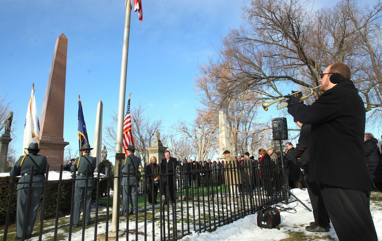 Trumpeter plays taps at the grave site of President Millard Fillmore in Buffalo, New York's Forest Lawn Cemetery, with a military honor guard and dignitaries from the University of Buffalo, which traces its founding to Fillmore. This is a Buffalo News photo of an earlier celebration, perhaps 2015.