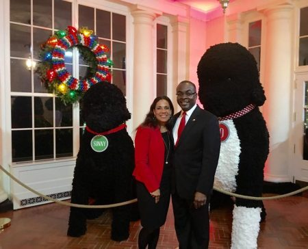 Browns posing with giant stuffed replicas of the Obama family dogs, Bo and Sunny.