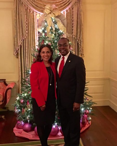 Michelle and Mayor Brown in front of another Christmas tree